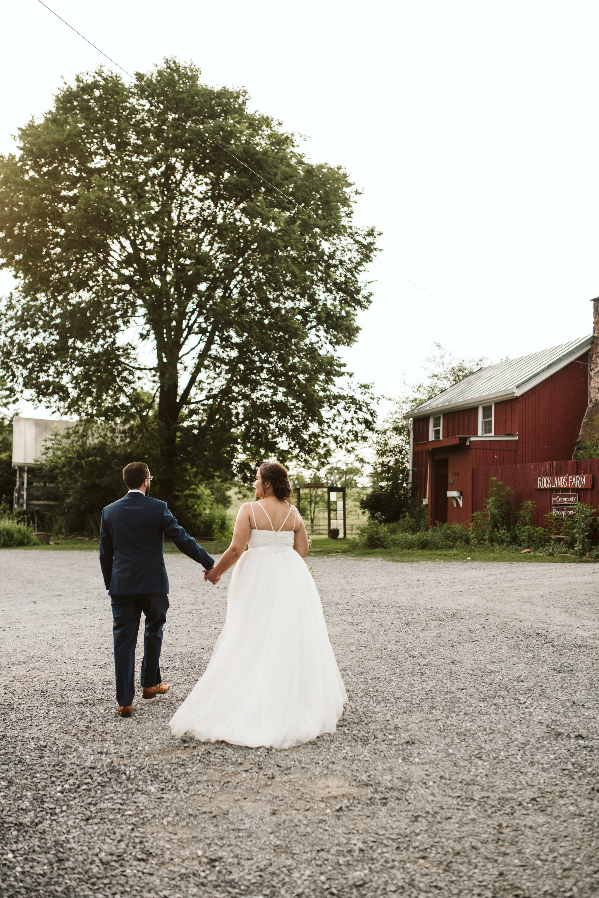 Rocklands Farm, Maryland, Intimate Wedding, Baltimore Wedding Photographer, Sungold Flower Co, Rustic, Romantic, Barn Wedding, Bride and Groom Holding Hands Walking Outside, Just Married