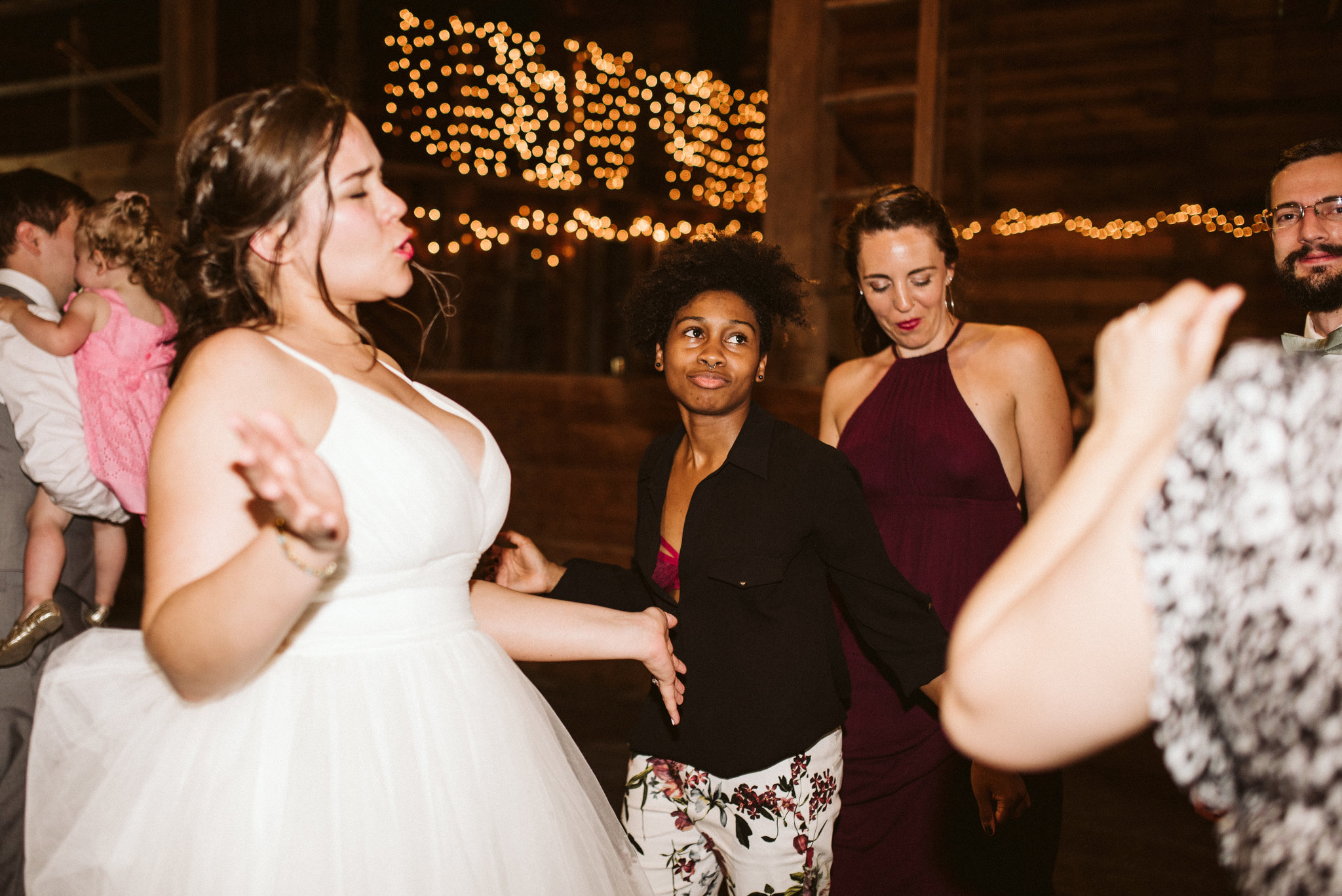 Rocklands Farm, Maryland, Intimate Wedding, Baltimore Wedding Photographer, Sungold Flower Co, Rustic, Romantic, Barn Wedding, Bride Dancing with Friends at Reception