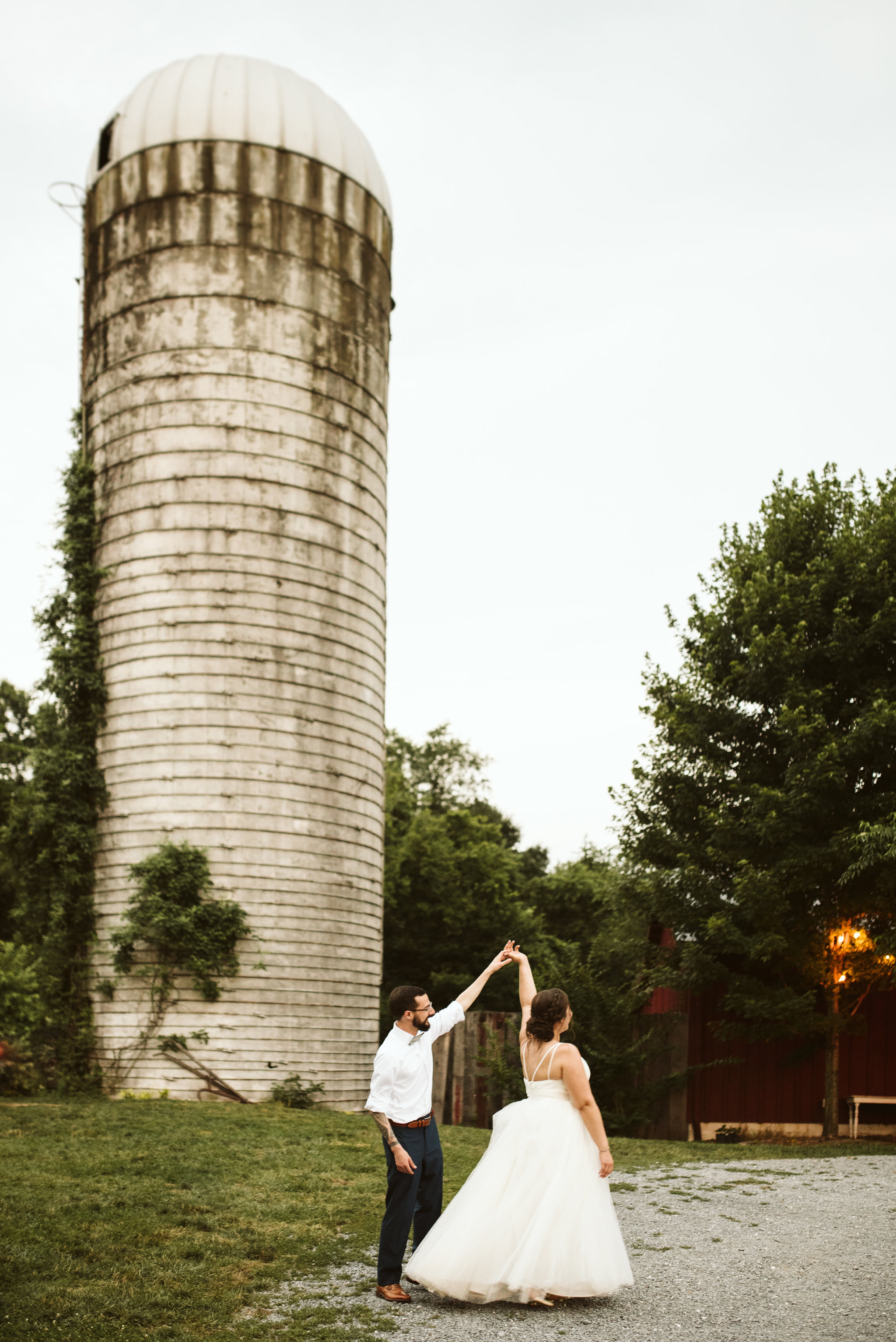 Rocklands Farm, Maryland, Intimate Wedding, Baltimore Wedding Photographer, Sungold Flower Co, Rustic, Romantic, Barn Wedding, Bride and Groom Dancing Outside by Silo