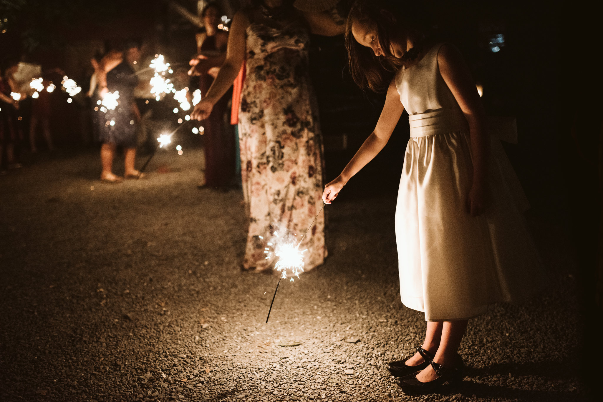 Rocklands Farm, Maryland, Intimate Wedding, Baltimore Wedding Photographer, Sungold Flower Co, Rustic, Romantic, Barn Wedding, Flower Girl Outside with Sparkler, Nighttime Photo