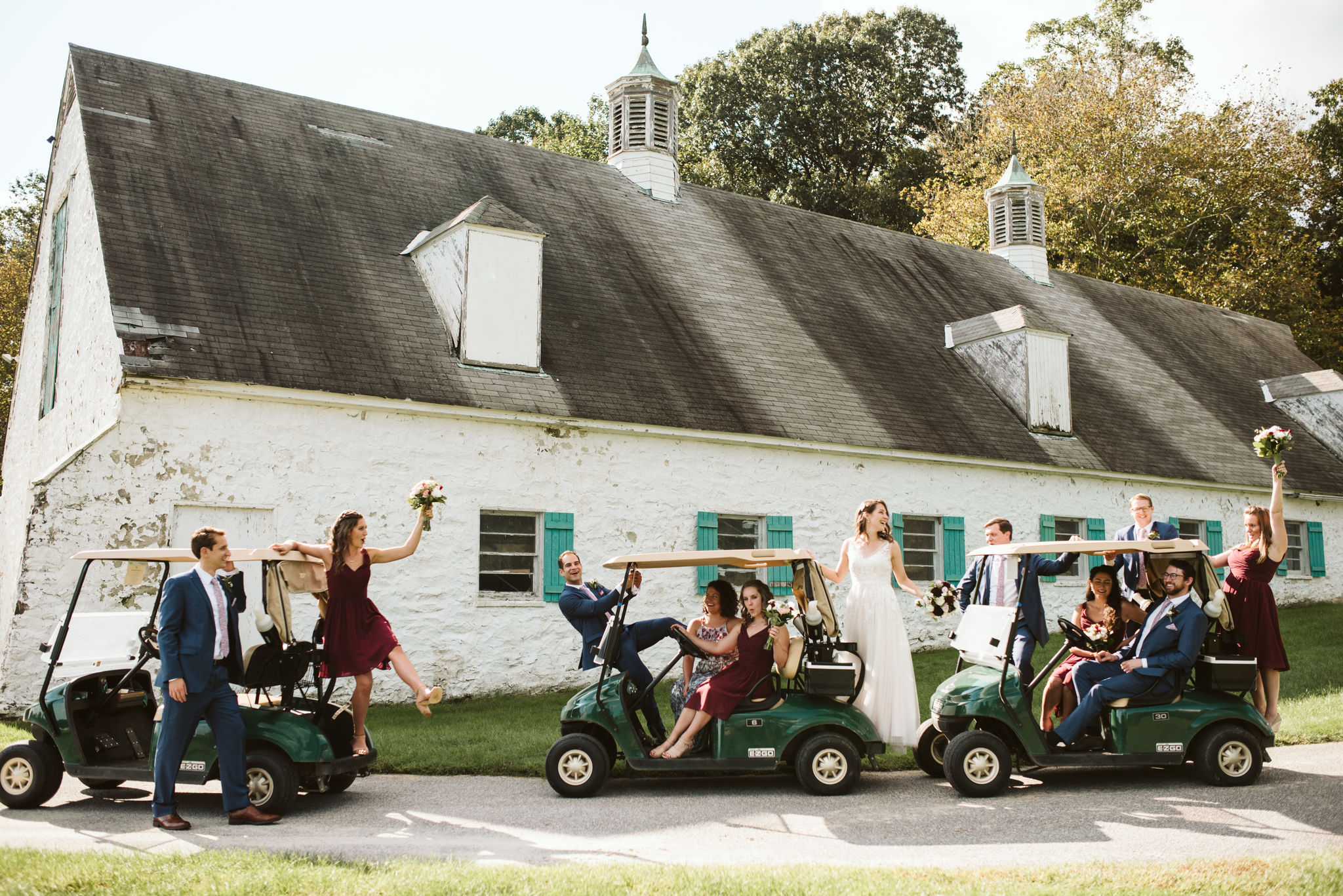 Phoenix Maryland, Baltimore Wedding Photographer, Eagle's Nest Country Club, Classic, Romantic, Fun Photo of Bridal Party on Golf Carts Outside Barn, Silly Portrait, Burgundy Brideside Bridesmaid Dresses