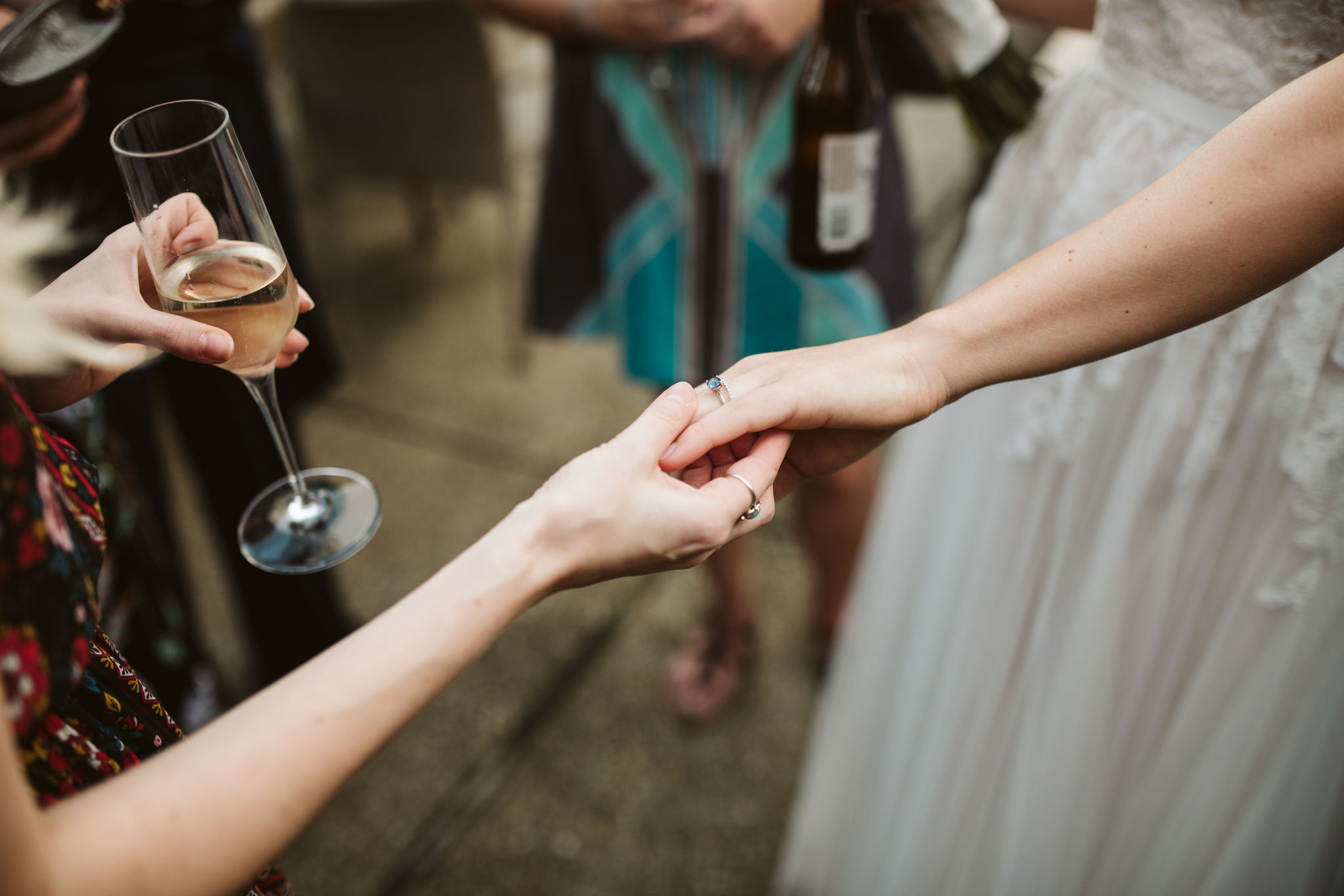 Phoenix Maryland, Baltimore Wedding Photographer, Eagle's Nest Country Club, Classic, Romantic, Spring, Bride Holding Hands with Friend, Wedding Guests Admiring Brilliant Earth Rings