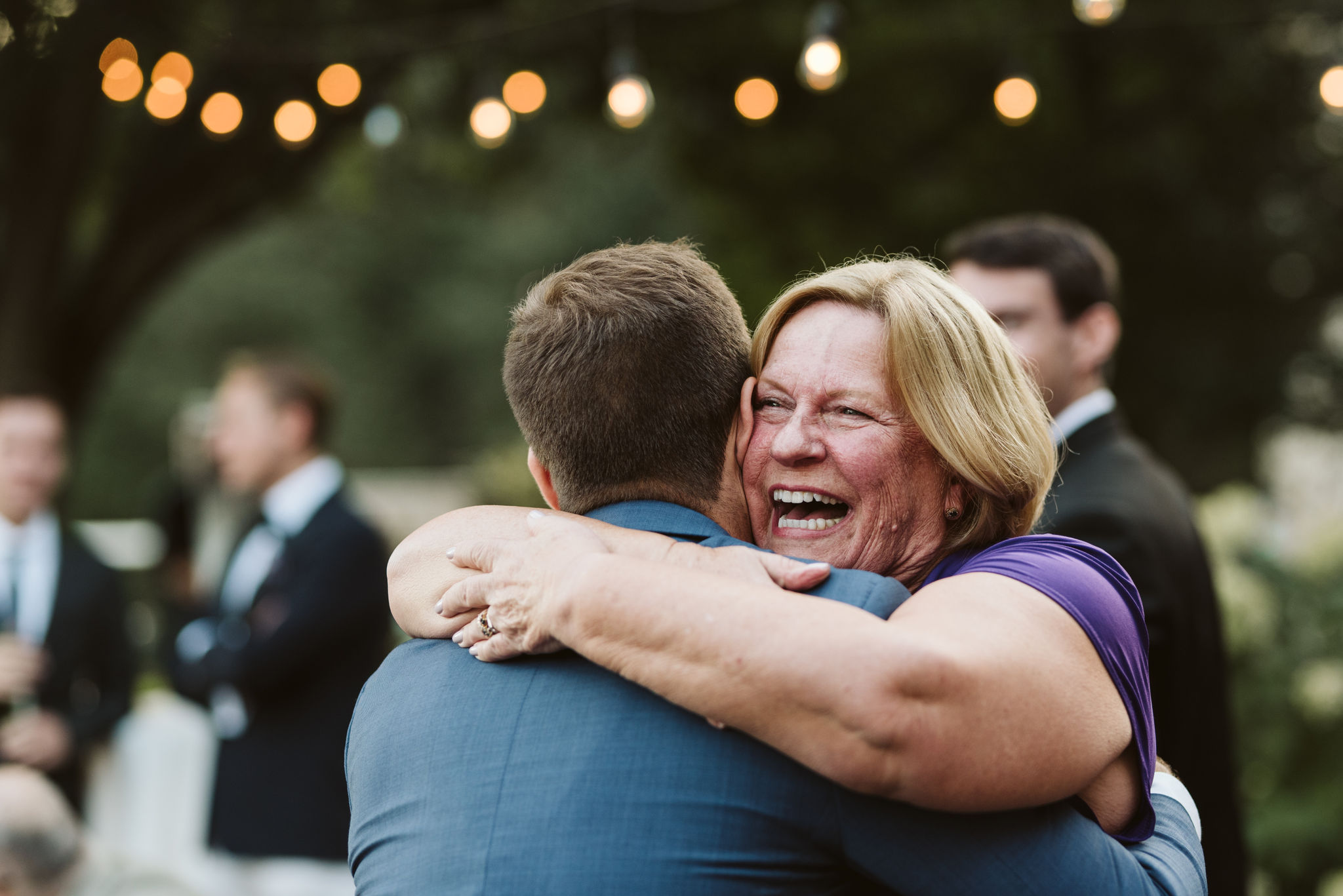 Phoenix Maryland, Baltimore Wedding Photographer, Eagle's Nest Country Club, Classic, Romantic, Family Hugging Groom, Wedding Guests Congratulating Groom