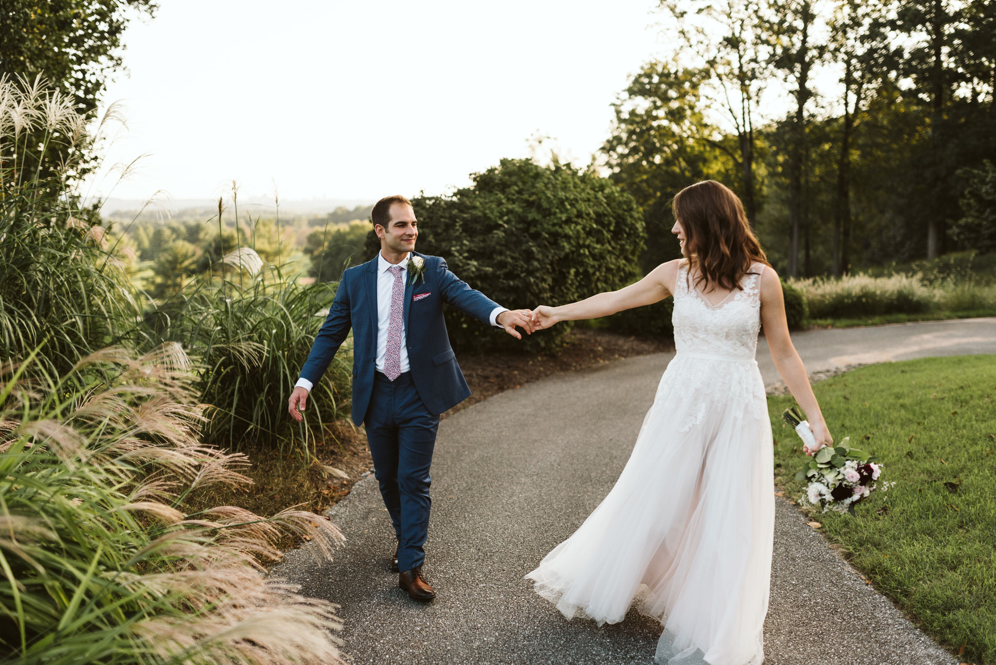 Phoenix Maryland, Baltimore Wedding Photographer, Eagle's Nest Country Club, Classic, Romantic, Couple Holding Hands on Nature Path, BHLDN Dress, Blue Suit from Generation Tux