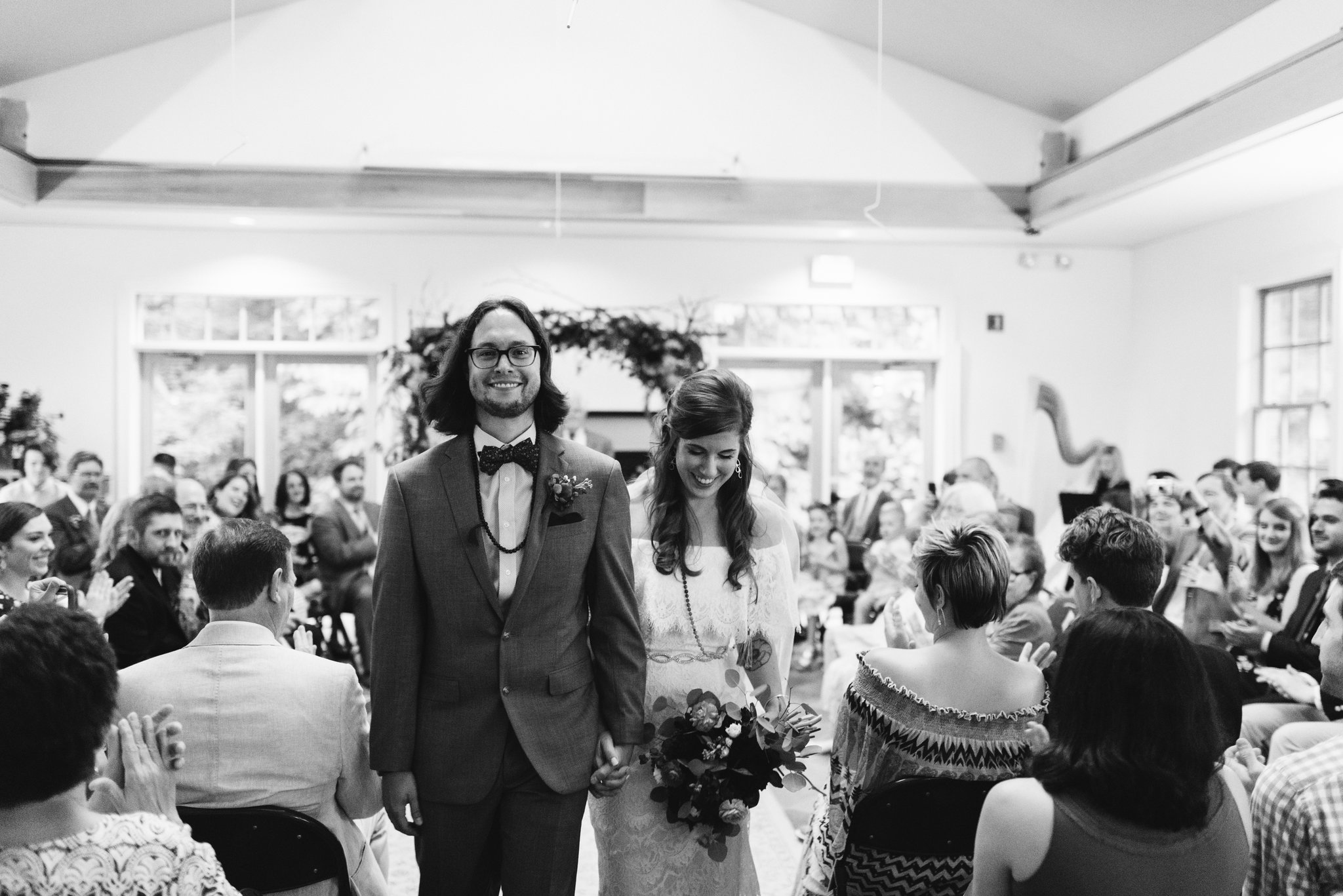 Annapolis, Quaker Wedding, Maryland Wedding Photographer, Intimate, Small Wedding, Vintage, DIY, Bride and groom Walking Down Aisle Together, Black and White Photo