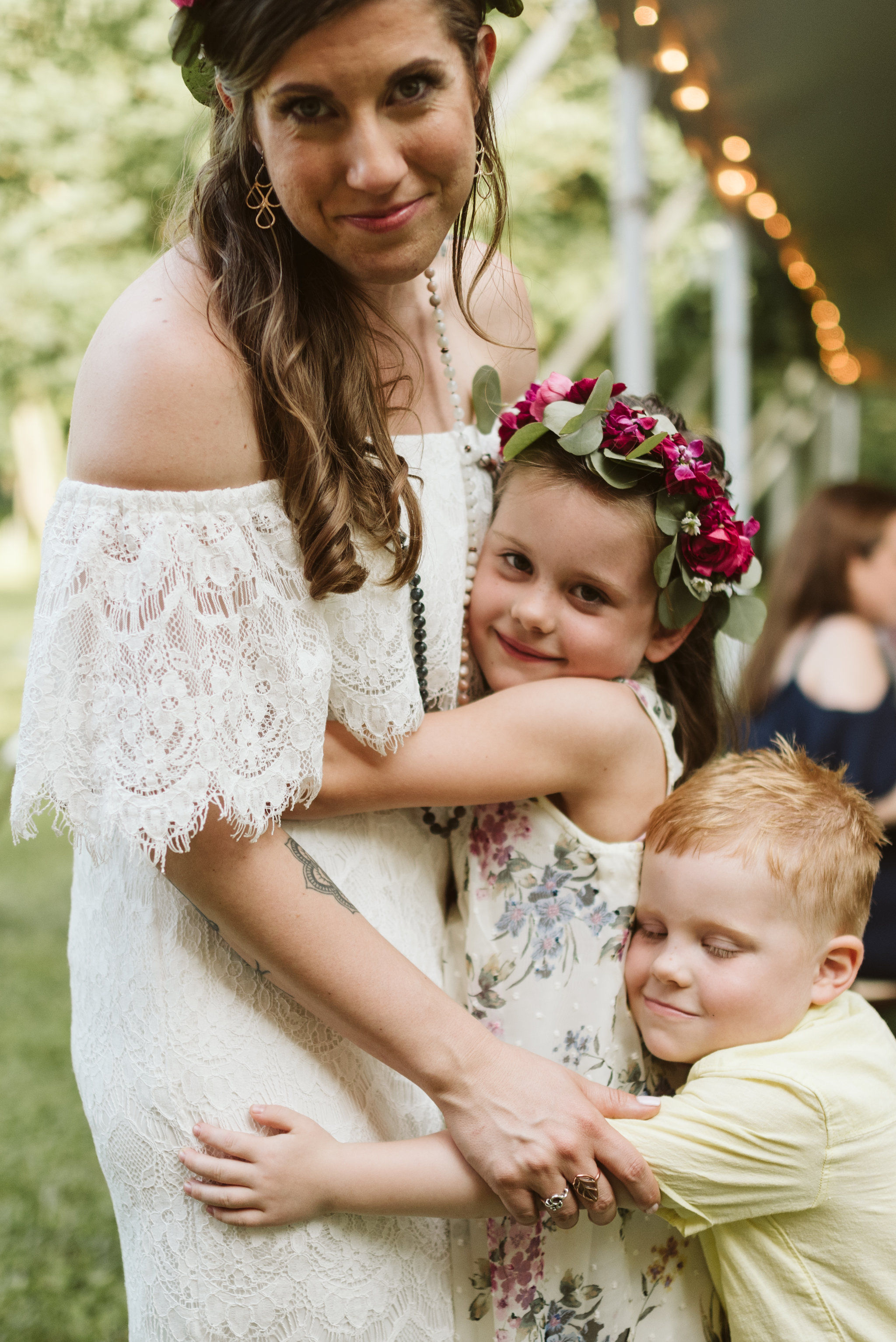 Annapolis, Quaker Wedding, Maryland Wedding Photographer, Intimate, Small Wedding, Vintage, DIY, Bride Hugging Kids at Reception, Sweet Photo of Bride with Children