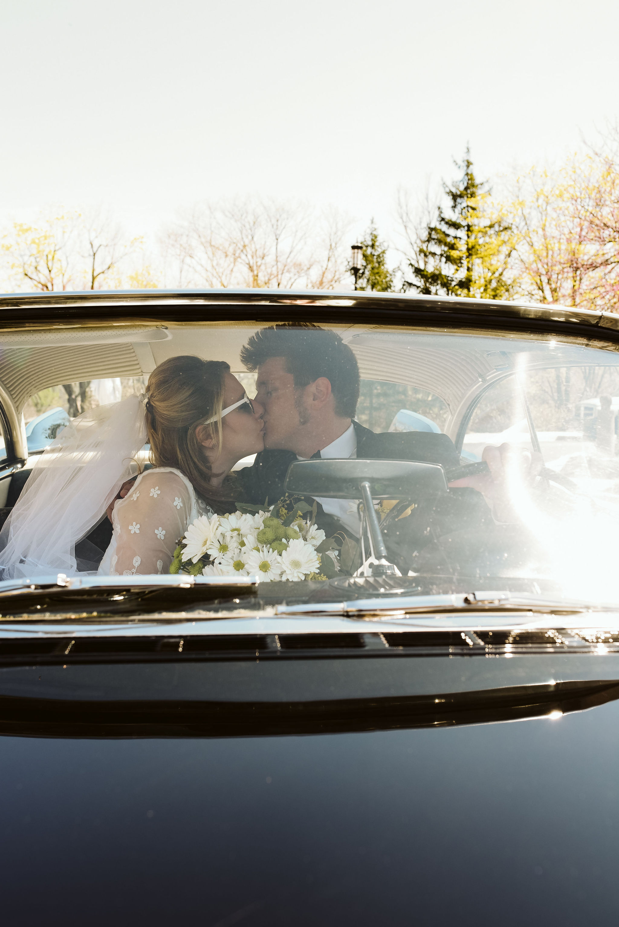 Baltimore, Church Wedding, Maryland Wedding Photographer, Vintage, Classic, 50s Style, Bride and Groom Kissing in Classic Car, White Daisies
