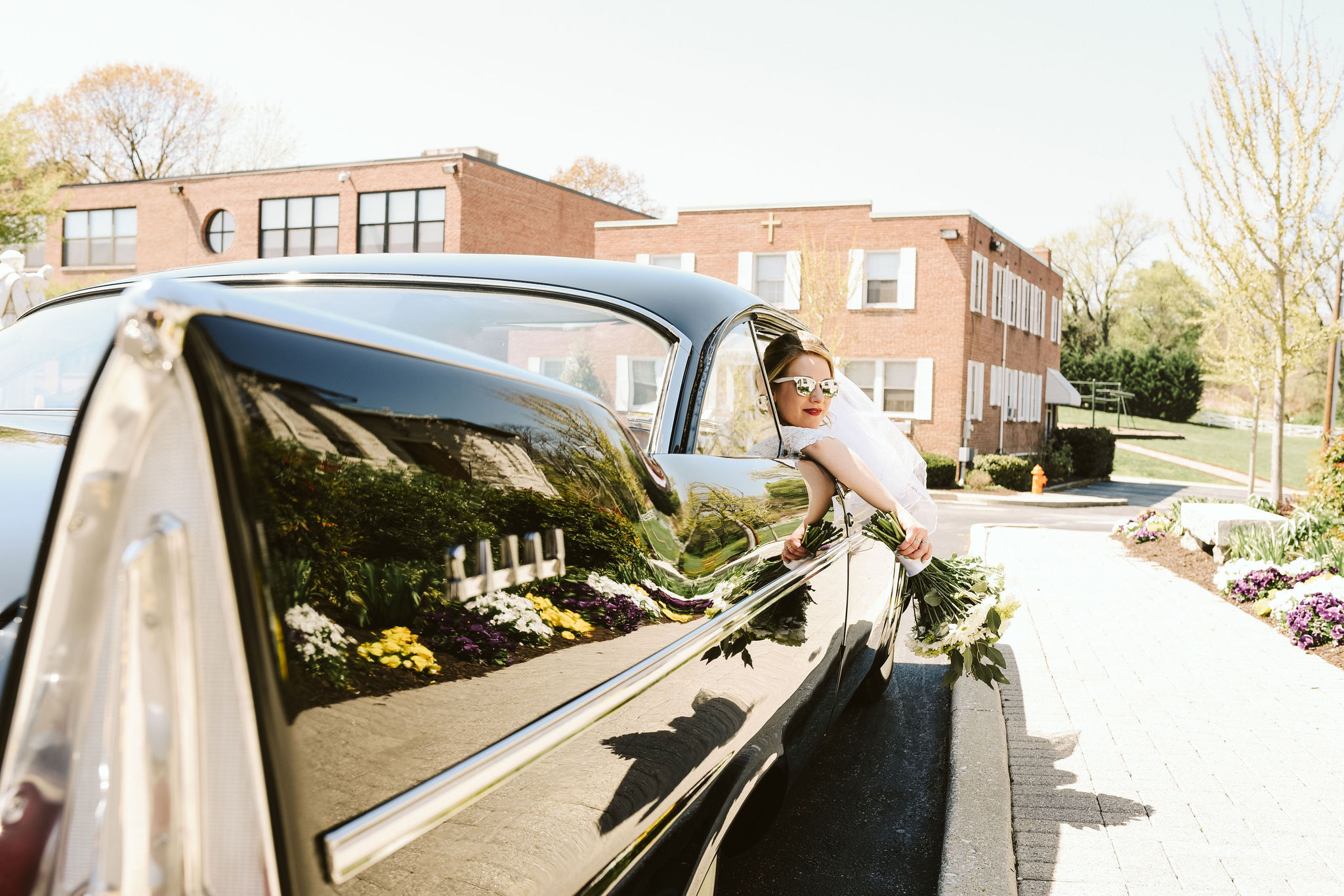 Baltimore, Church Wedding, Maryland Wedding Photographer, Vintage, Classic, 50s Style, Bride Leaning Out Window of Classic Car, White Sunglasses, Baltimore City