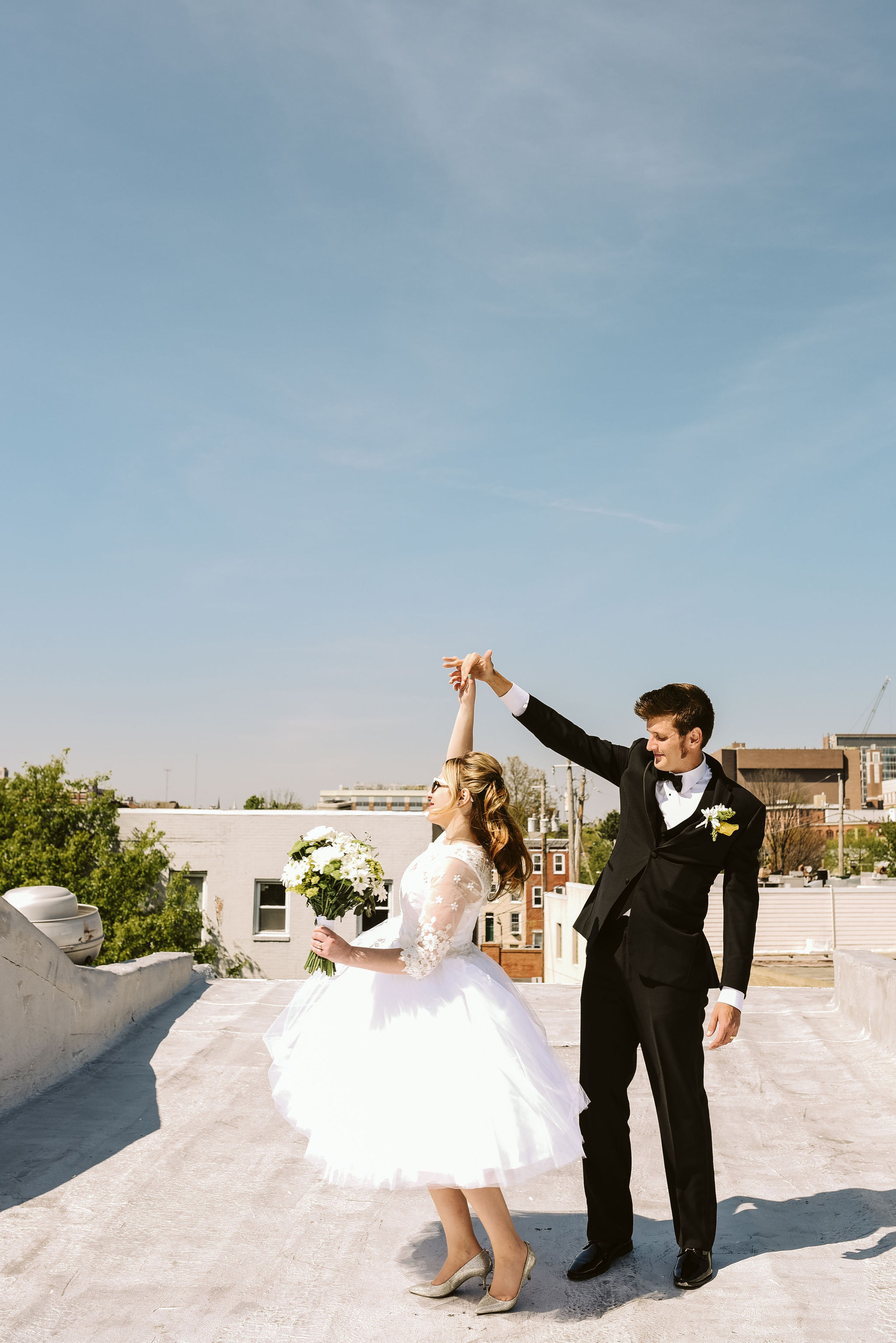 Baltimore, Church Wedding, Maryland Wedding Photographer, Vintage, Classic, 50s Style, Groom Twirling Bride, Dancing on Rooftop, Black Suit, Lace and Tulle Wedding Dress, Outdoor