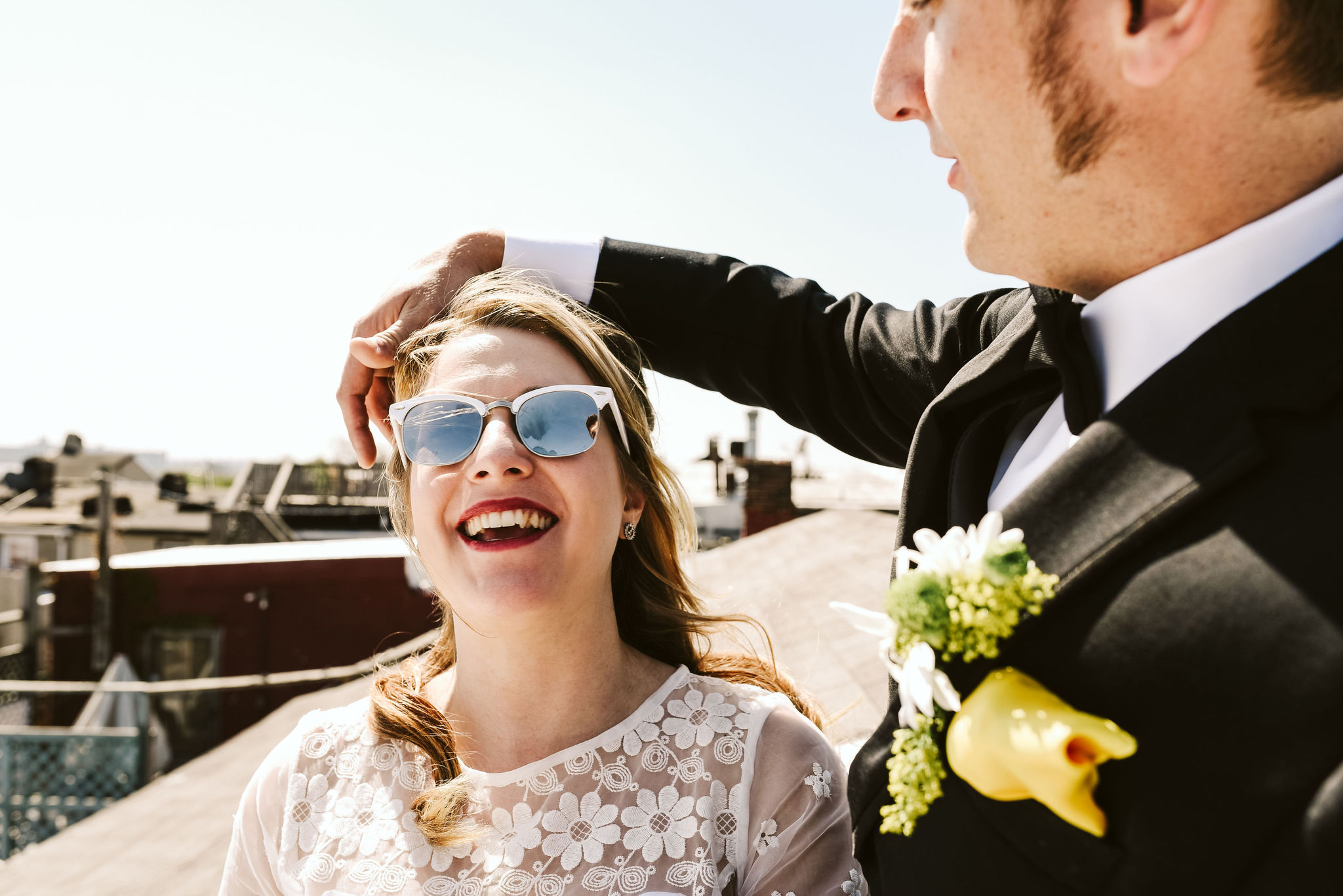 Baltimore, Church Wedding, Maryland Wedding Photographer, Vintage, Classic, 50s Style, Groom Moving Hair Out of Bride's Face, Windy Sunny Day, Bride Laughing and Smiling