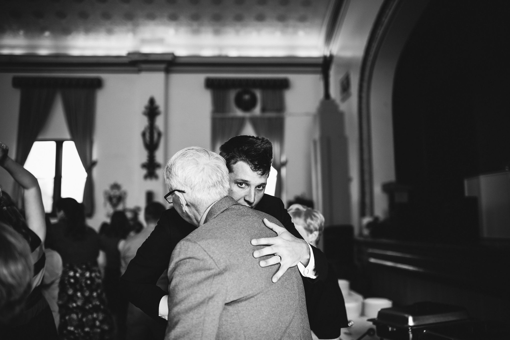 Baltimore, Lithuanian Dance Hall, Maryland Wedding Photographer, Vintage, Classic, 50s Style, Groom with Family, Groom Welcoming Guests, Black and White Photo