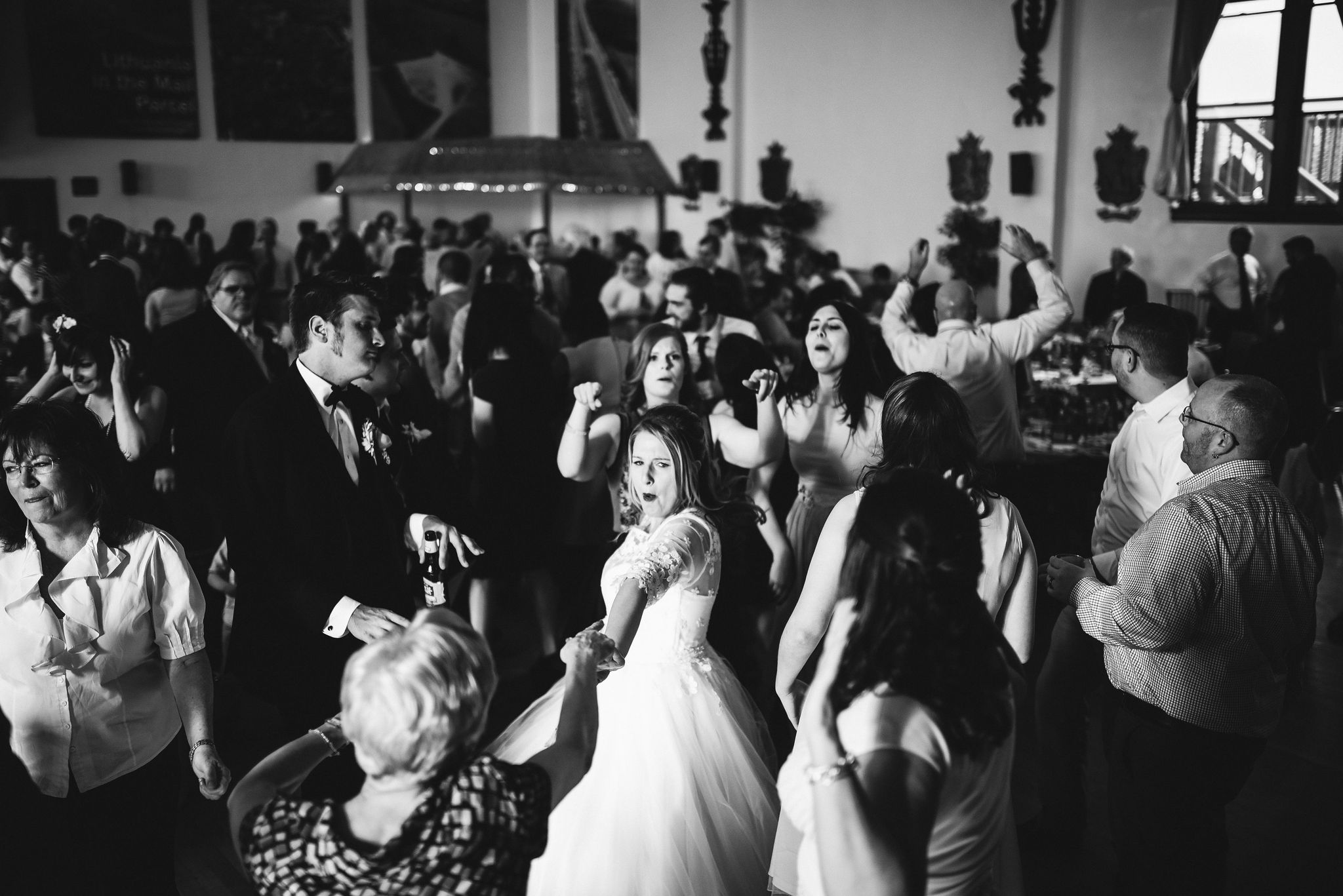 Baltimore, Lithuanian Dance Hall, Maryland Wedding Photographer, Vintage, Classic, 50s Style, Bride Dancing with Family, Black and White Photo, Wedding Guests Having Fun