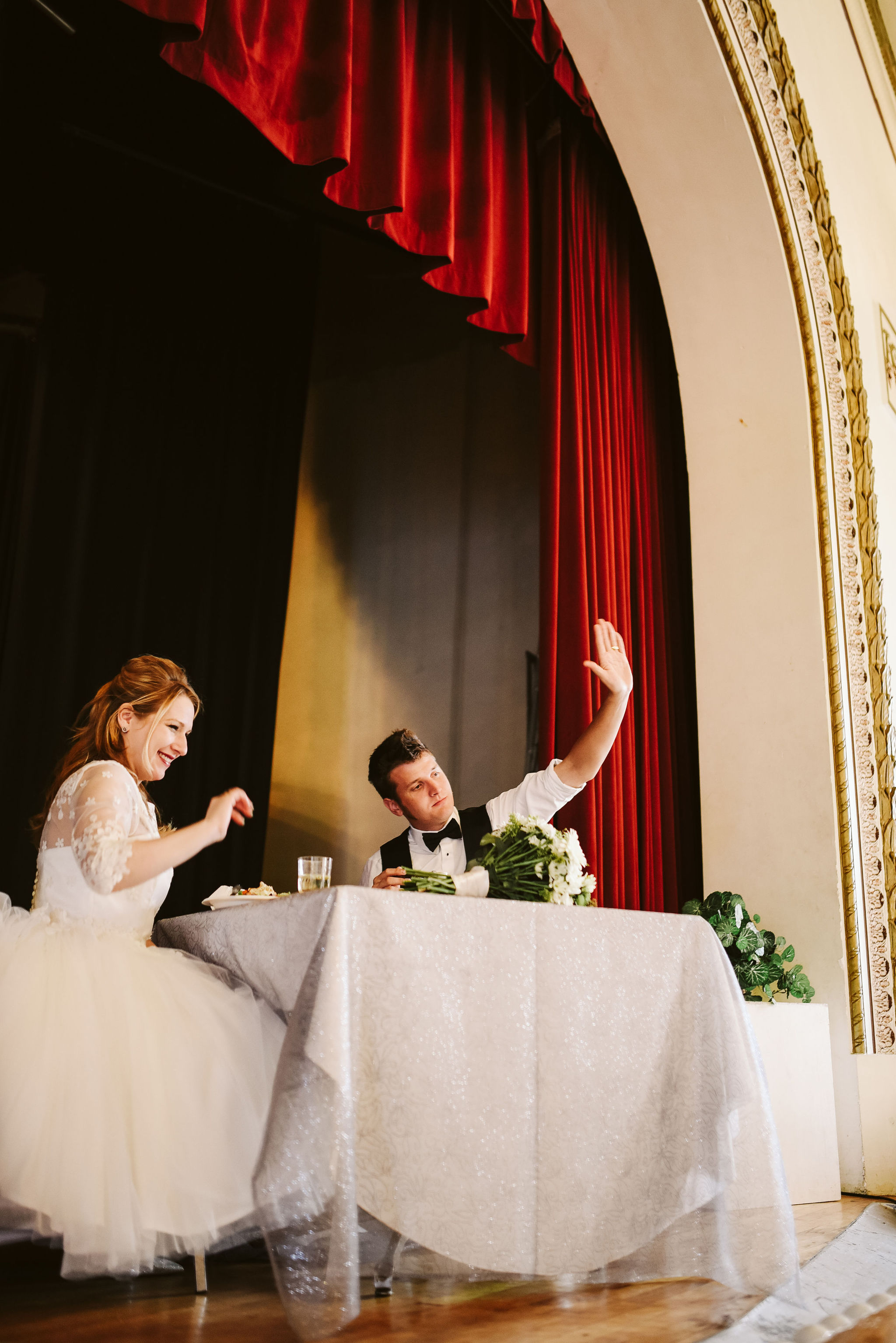 Baltimore, Lithuanian Dance Hall, Maryland Wedding Photographer, Vintage, Classic, 50s Style, Bride and Groom at Head Table, Couple Waving to Crowd at Reception