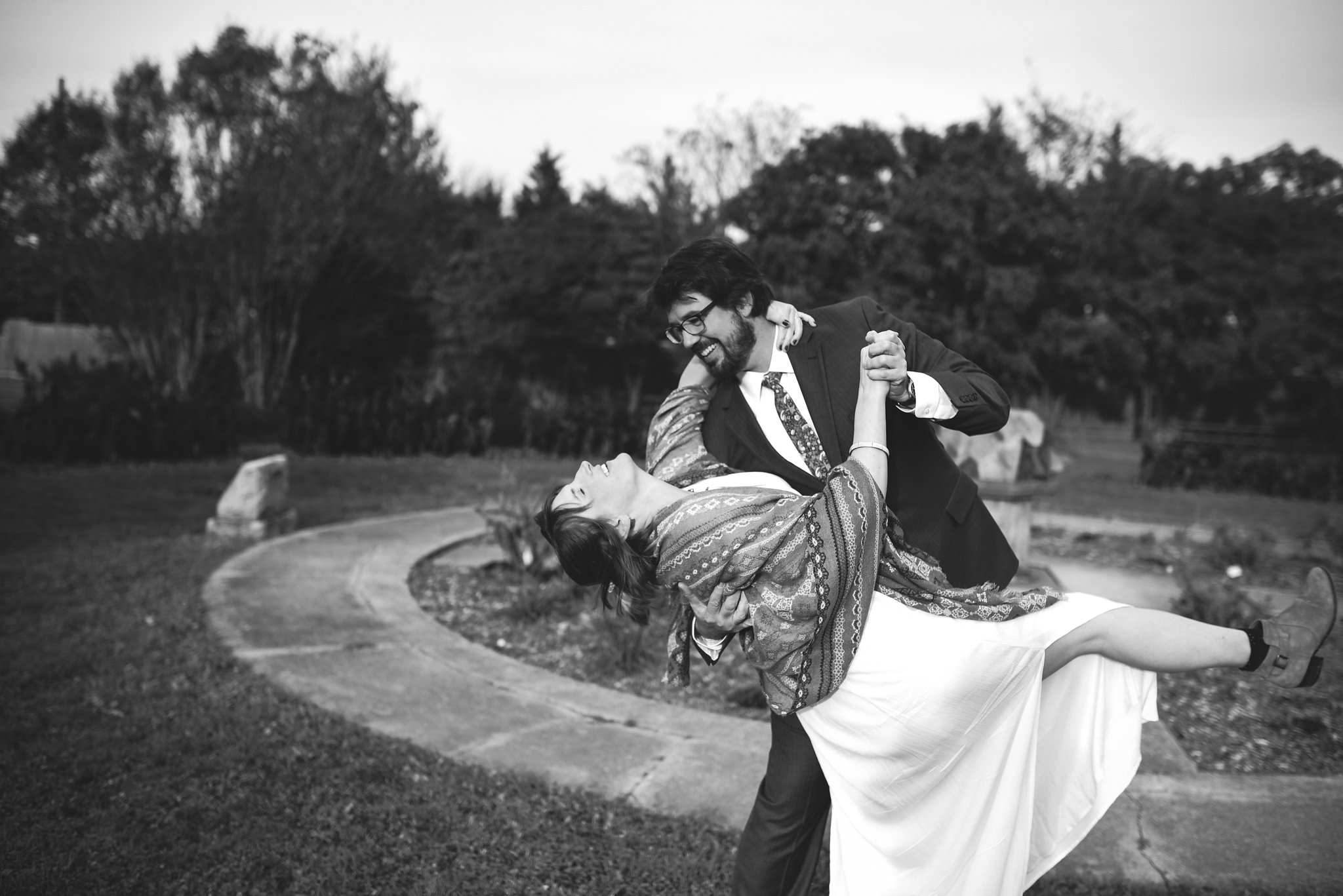 Rawlings Conservatory, Druid Hill Park, Intimate Wedding, Nature, Baltimore Wedding Photographer, Romantic, Classic, Groom Dipping Bride Outside, Black and White Photo, Couple Dancing