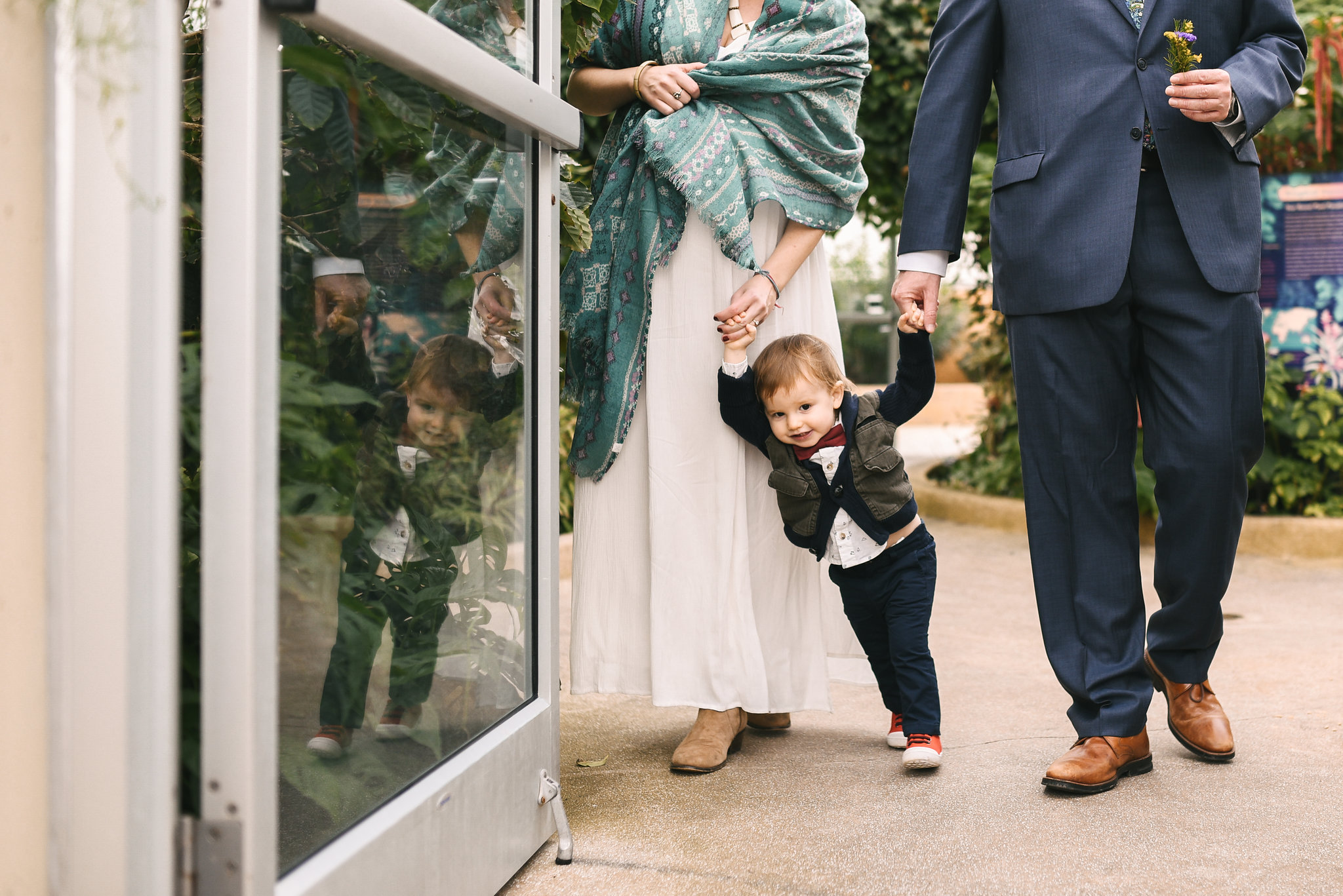 Rawlings Conservatory, Druid Hill Park, Intimate Wedding, Nature, Baltimore Wedding Photographer, Romantic, Classic, Bride and Groom Holding Hands on Infant Son, Sweet Family Photo