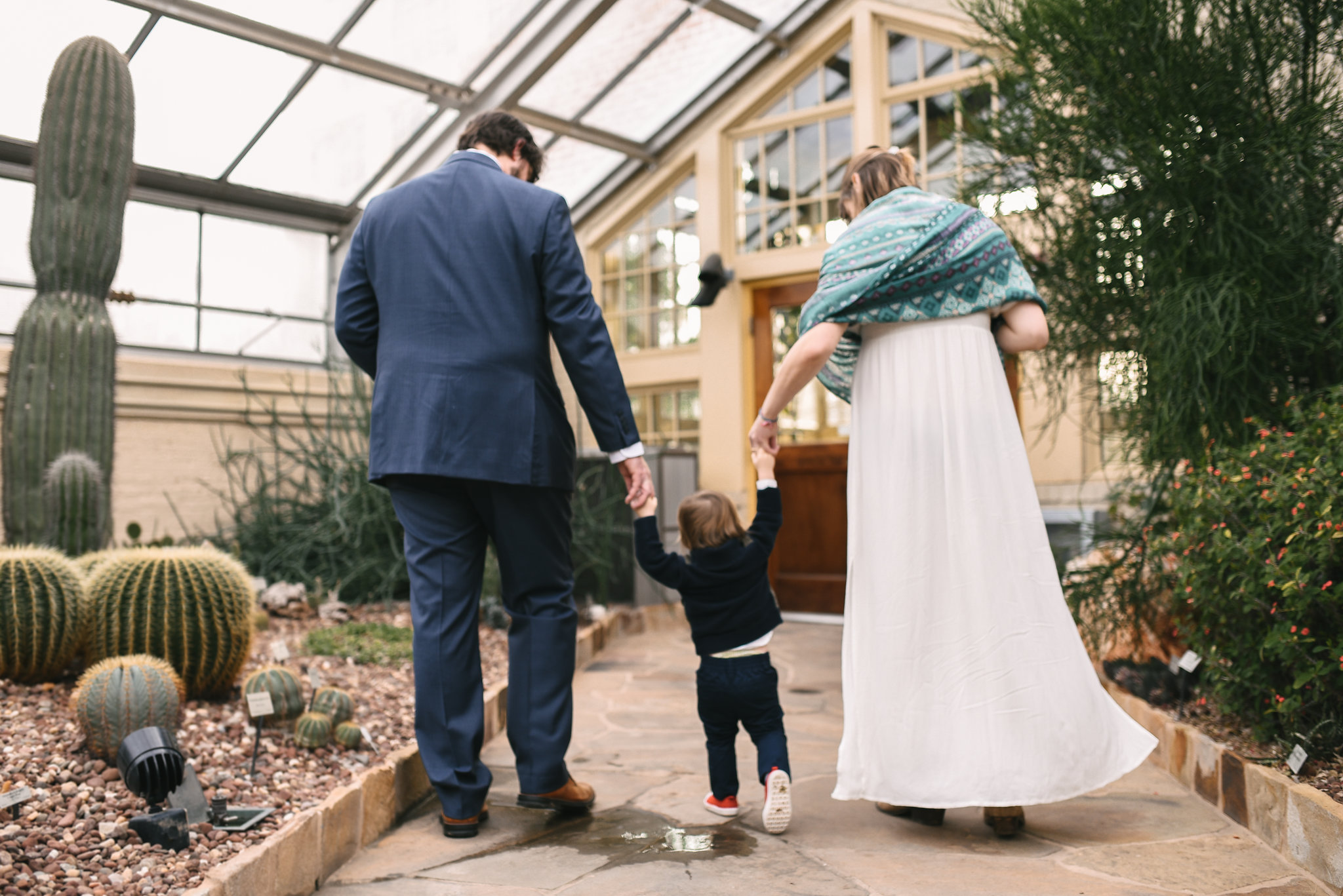 Rawlings Conservatory, Druid Hill Park, Intimate Wedding, Nature, Baltimore Wedding Photographer, Romantic, Classic, Bride and Groom Walking with Infant Son, Candid Photo