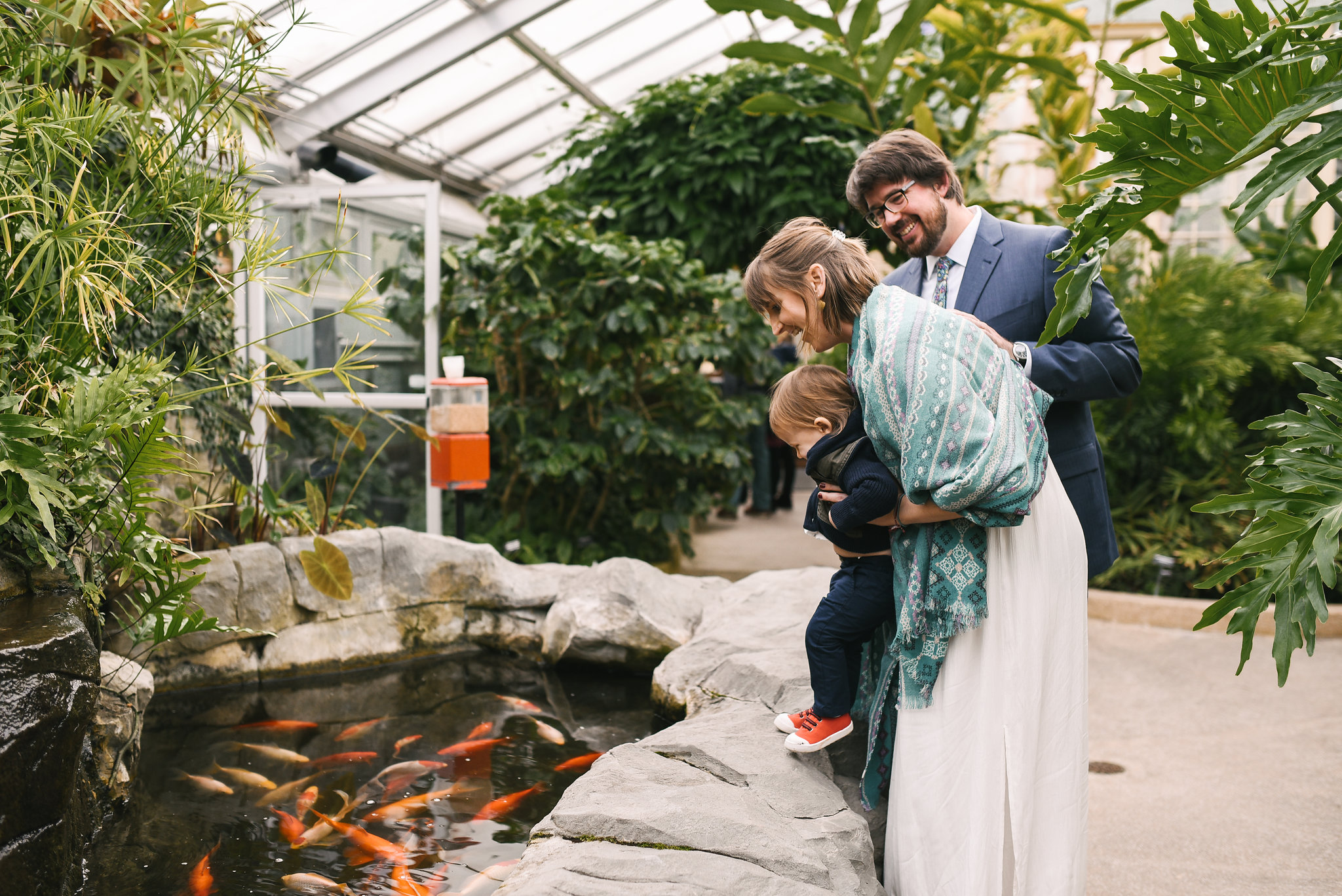 Rawlings Conservatory, Druid Hill Park, Intimate Wedding, Nature, Baltimore Wedding Photographer, Romantic, Classic, Bride and Groom with Son Looking at Koi Fish, Family Portrait