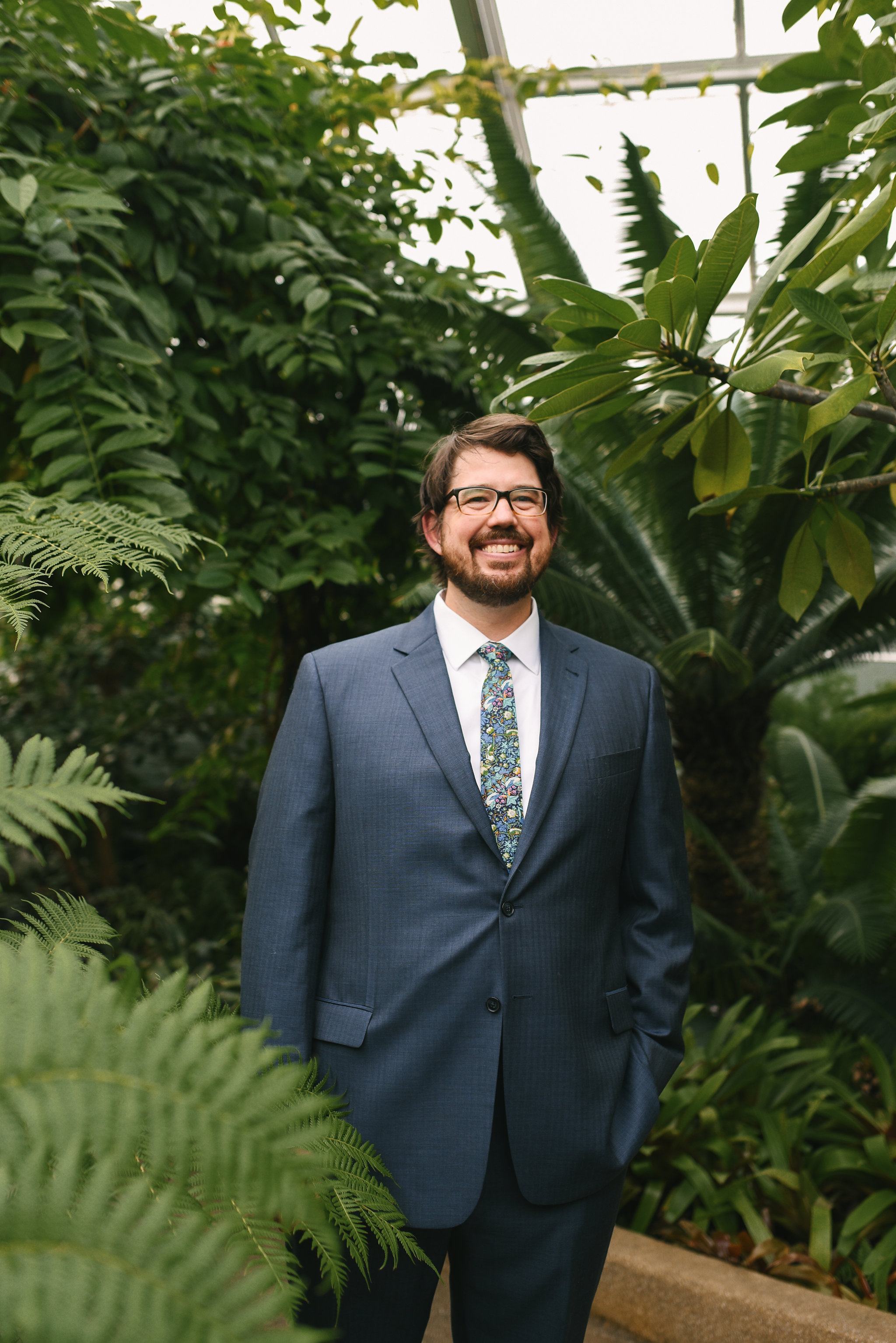 Rawlings Conservatory, Druid Hill Park, Intimate Wedding, Nature, Baltimore Wedding Photographer, Romantic, Classic, Portrait of Groom Among Trees, Floral Tie, Blue Groom's Suit
