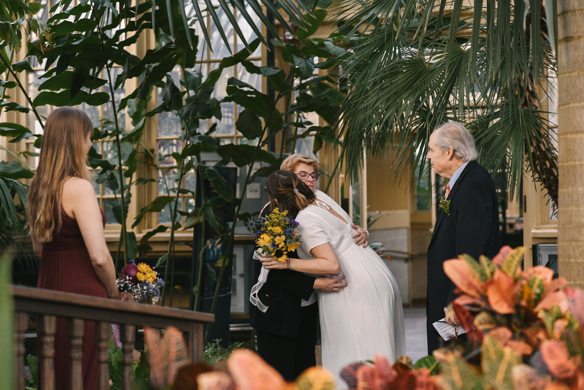 Rawlings Conservatory, Druid Hill Park, Intimate Wedding, Nature, Baltimore Wedding Photographer, Romantic, Classic, Bride Hugging Mother of the Bride Surrounded by Flowers