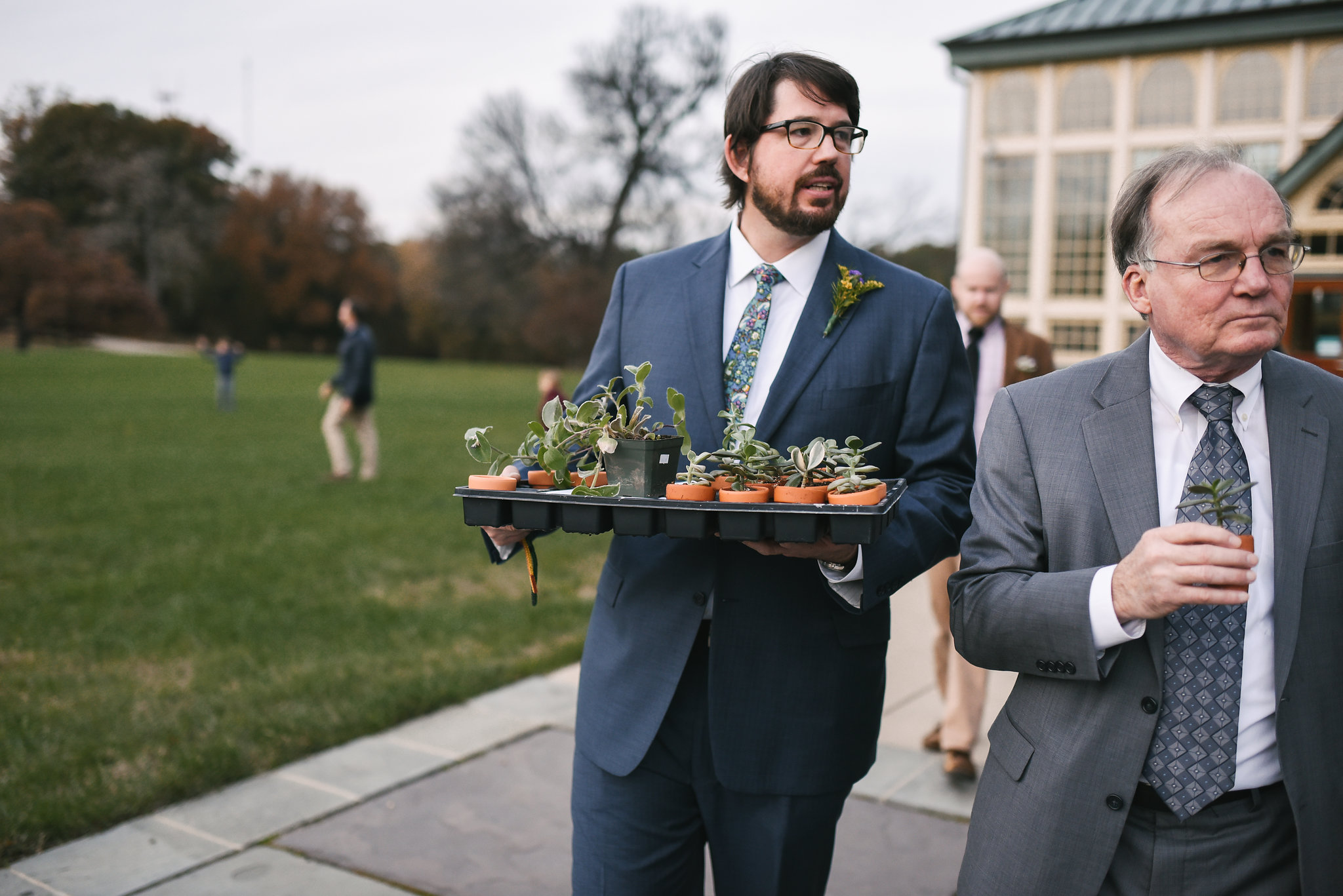 Rawlings Conservatory, Druid Hill Park, Intimate Wedding, Nature, Maryland Wedding Photographer, Romantic, Classic, Groom Walking with Succulent Wedding Favors