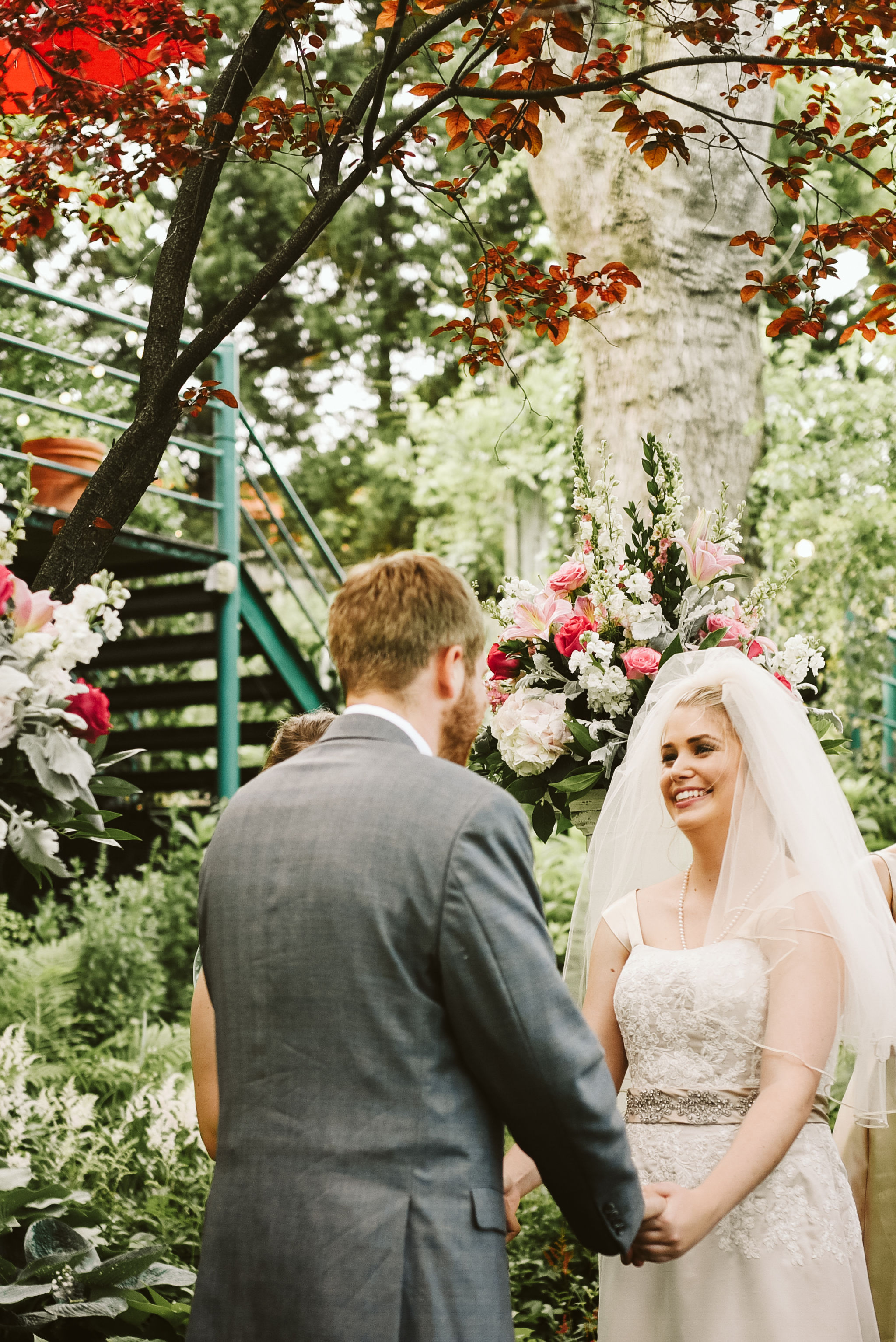Hampden, Baltimore, Maryland Wedding Photographer, Garden Wedding, Classic, DIY, Romantic, Bride and Groom Smiling at Each Other During Ceremony