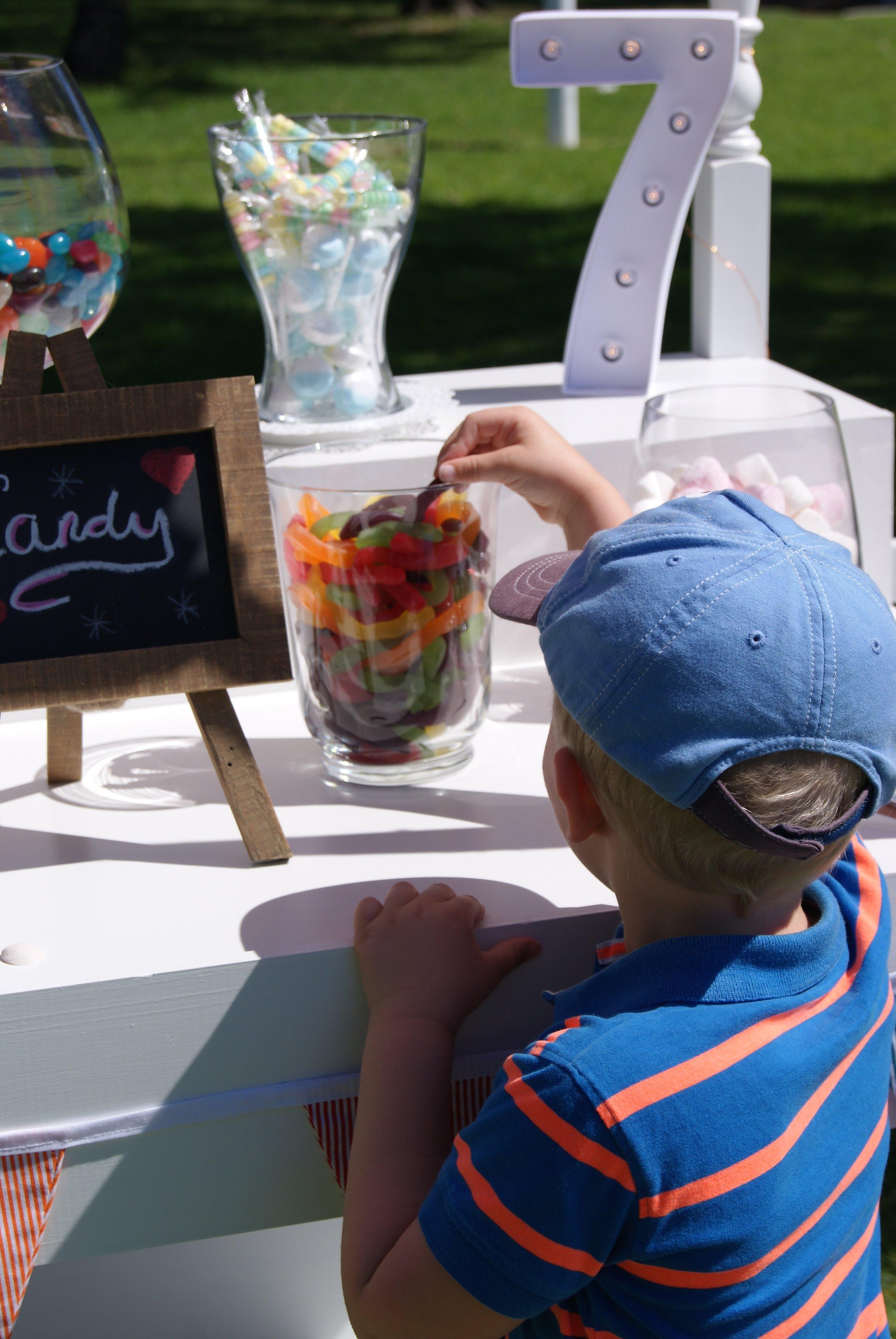 Boy_Taking_Lolly_Snake_Little Lolly Cart.jpg