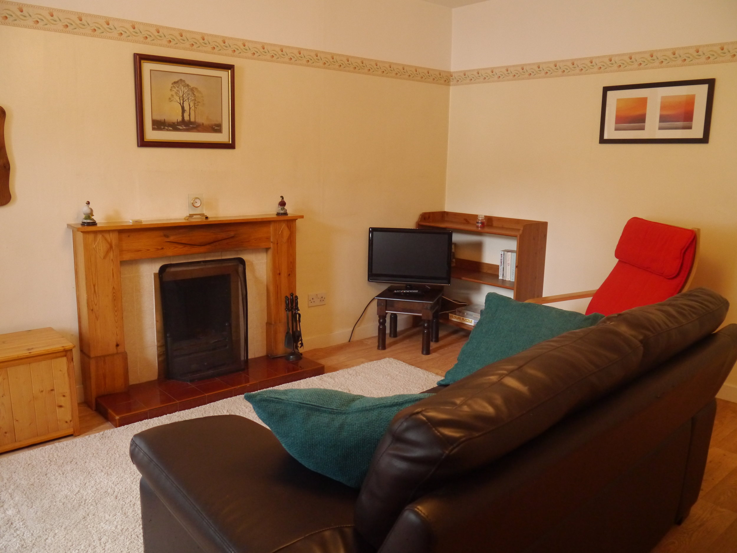 The spacious living room has an open fire ,TV and DVD player. There is also a collection of DVDs and Books.