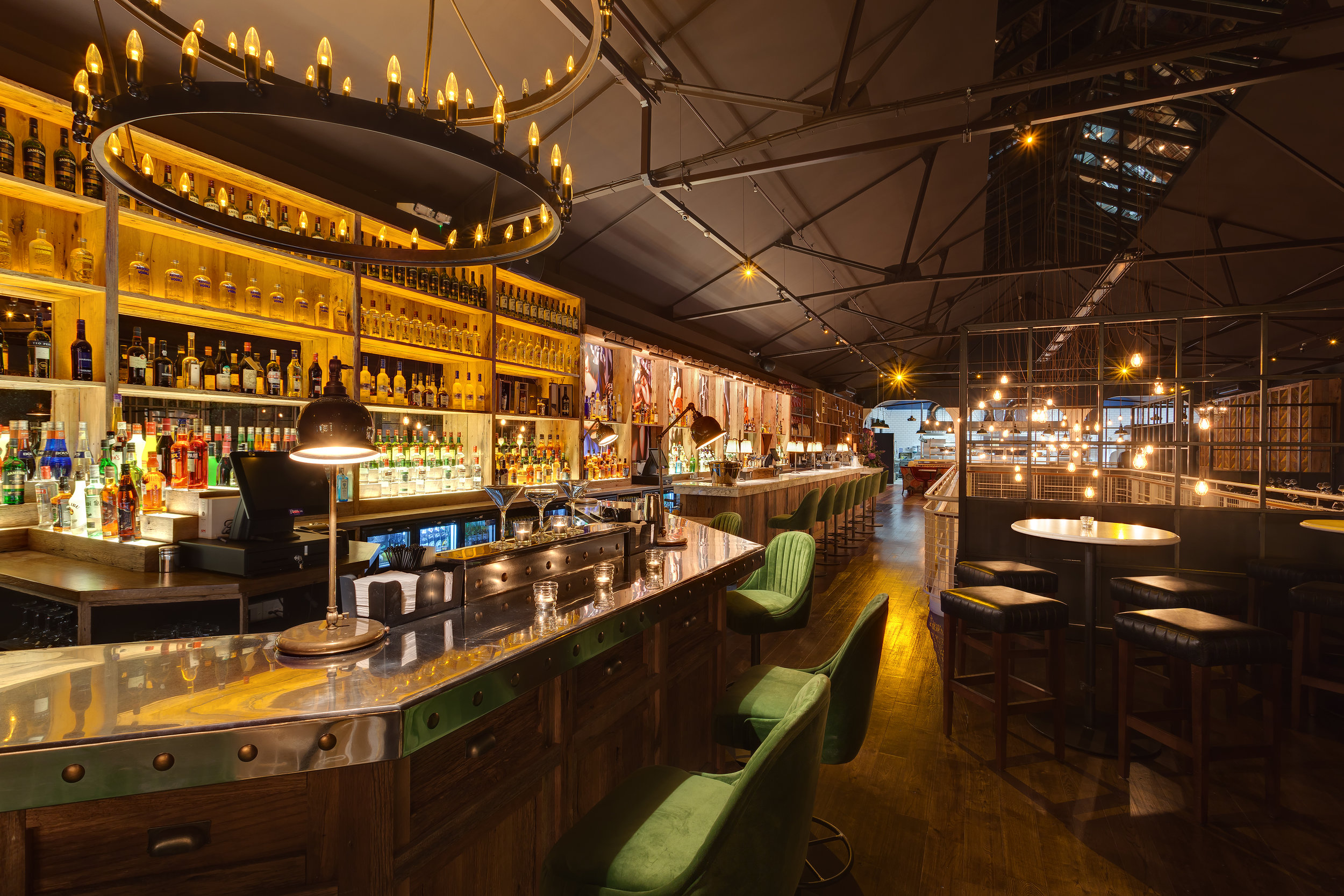 PUBLIC BAR - The Public Bar in Tribeton runs almost the length of the venue and features a beautiful re-claimed oak base with Italian marble counter top on the main bar and a shining Belfast pewter top on the cocktail bar. Pewter was once only for the wealthy in Ireland and was found on the tables of castle halls. Today we have combined over 800 years of Irish Pewter with modern day metalwork to create a stunning focal point for our guests.Above the cocktail bar hangs a specially commissioned bronze two tiered cartwheel chandelier which was modelled on an original  smaller lantern sourced in Cornwall in over 20 years ago and now hangs in Kirwan's lane. The medieval style is a celebration of the history of Galway and a love of ancient crafts honed from generation to generation.The Public Bar is situated in the heart of our venue, so you can have pre-dinner drinks before heading into the Restaurant, or you can stay here all night long.Join us in the evenings for elegant cocktails - we specialise in sours, .martinis and gin & tonic. We are the biggest gin bar in the Connacht with over 130 gins in stock, including our own brand Galway Gin Co.Check our What's on page where you can find the latest news & events from Tribeton.Our monthly events line-up has the key dates for your diary.