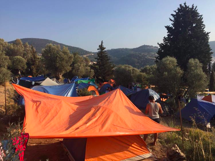 Tents currently fill the extended area of the camp on Samos where families live for months on end in cold and rainy conditions. By Melissa Pawson. Samos, Greece: 2018. JPG file.