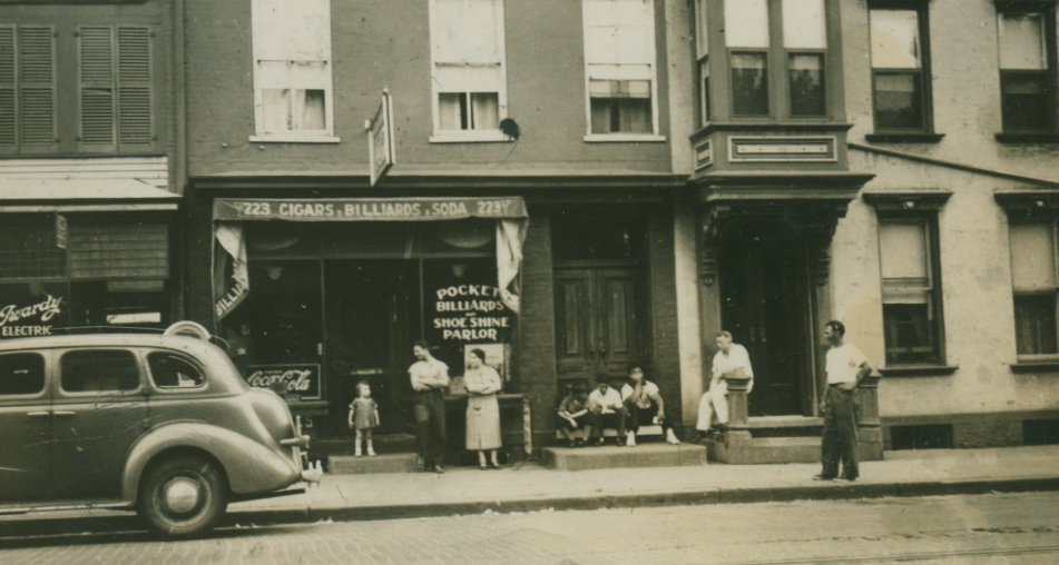 "In earlier days...the woman beneath the ""pocket billiards"" sign is my grandmother, Anna Borrelle."