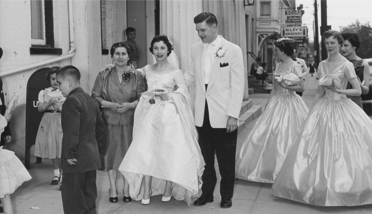 Mom and Dad on their wedding day with her mother, Anna Borrelle. In the background is the General Worth Hotel, which was just a few steps from where my mother grew up.