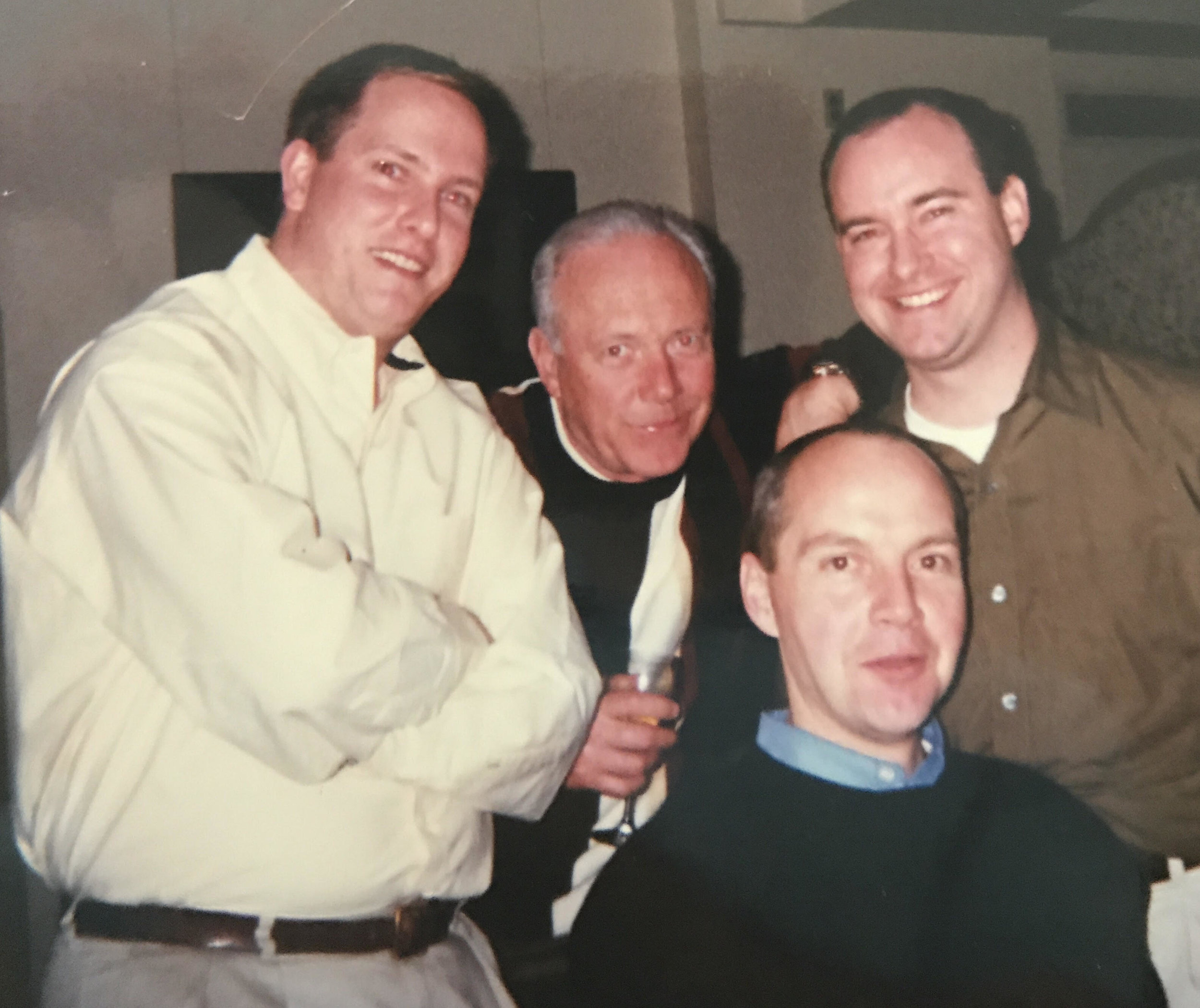 Bill Lane flanked by GE colleagues Christian Flathman (left) and Jeff DeMarrais (right) with me seated. This is a 2001 send-off party for Jeff who had been named head of communications for our locomotive business in Erie, PA.