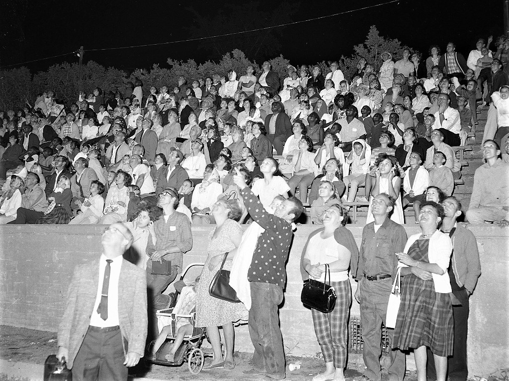 A crowd in the football grandstands at Hudson High School watching fireworks at the Hudson Police Youth Day in 1963. Photo by Howard Gibson.