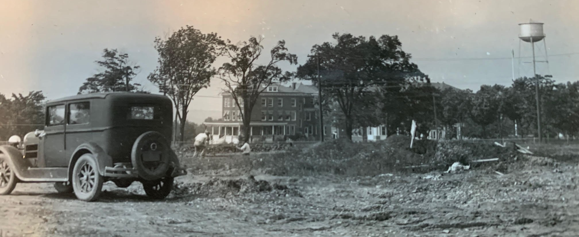 The early days of construction for Hudson's new high school. In the background is the former Firemen's Home.