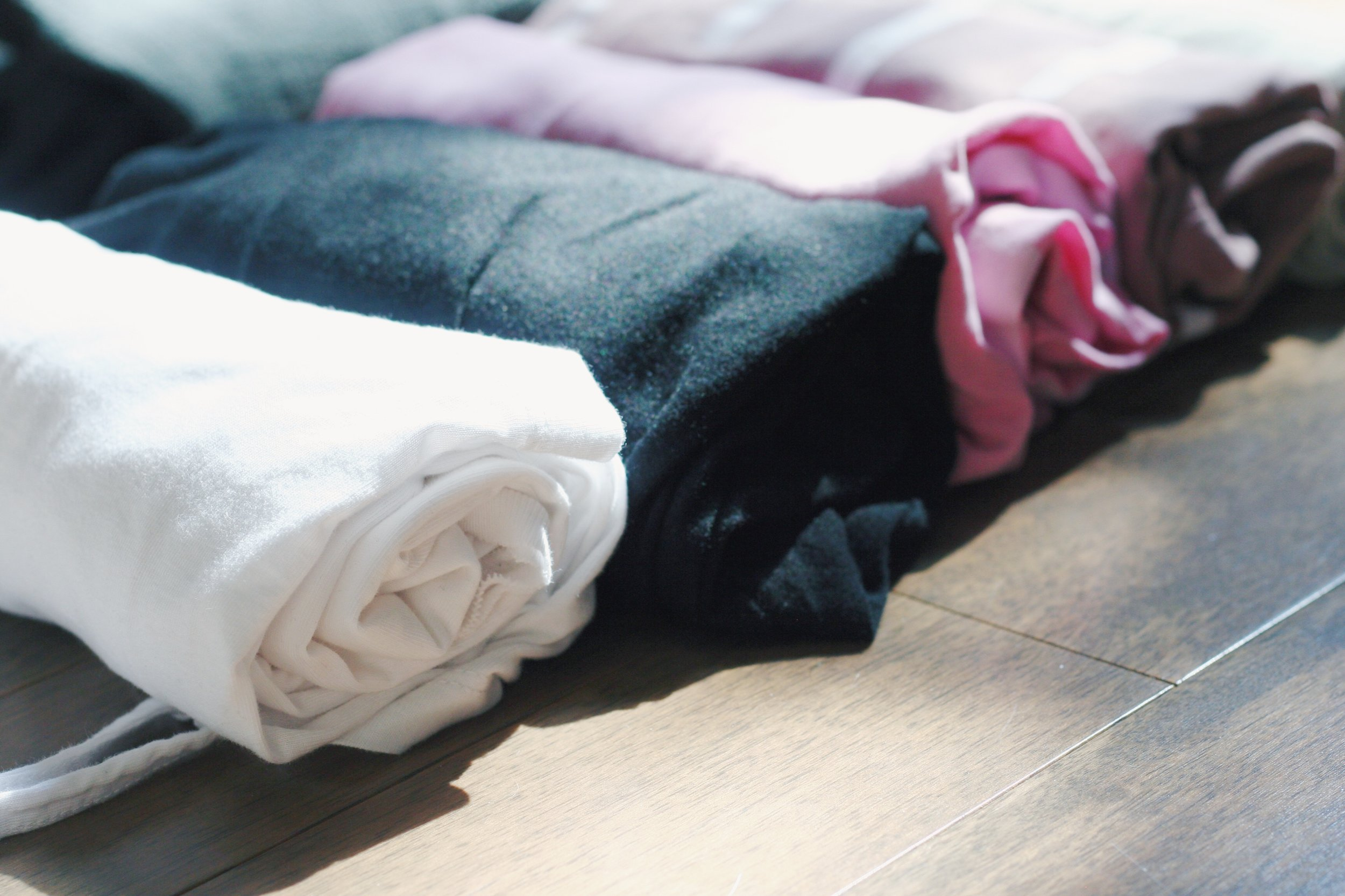 Rolling your clothes is a great way to save space and to organize your suitcase