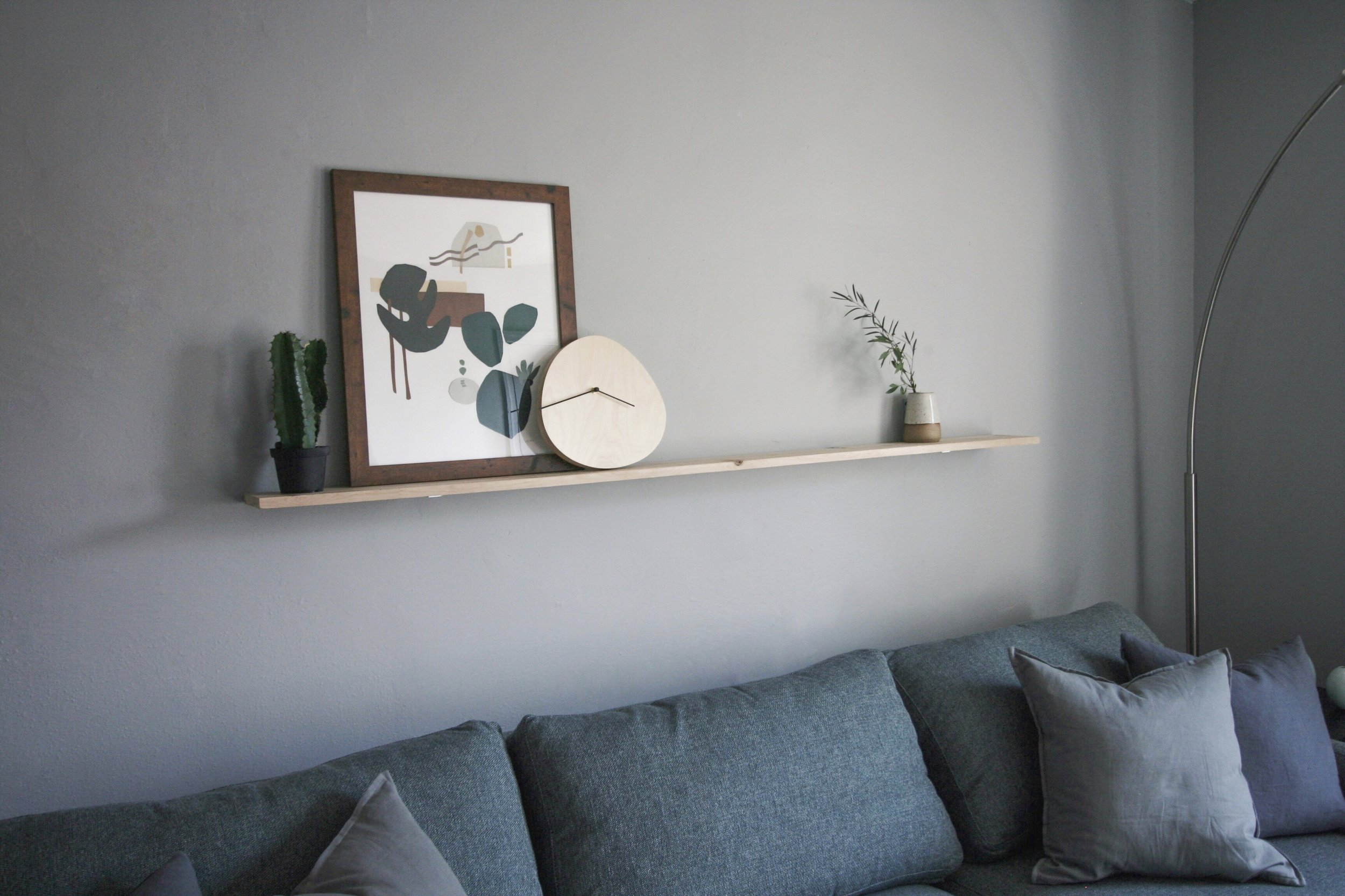 I installed this floating shelf to feature a few special things including an original collage artwork