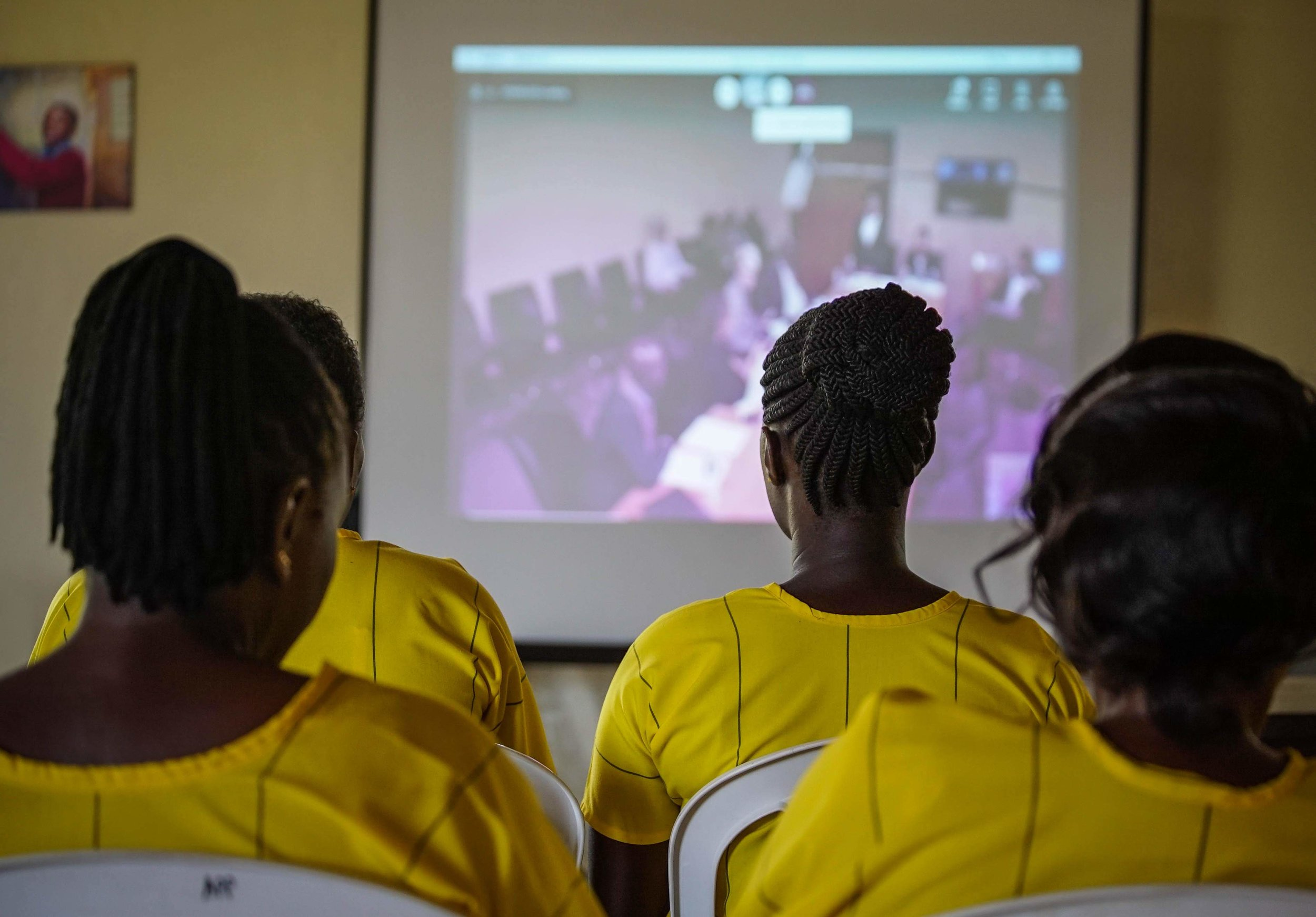 Female students watching live-streamed moot.
