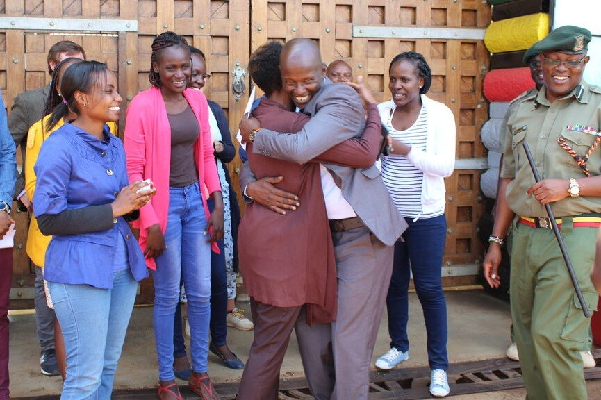 Morris Kaberia being received by APP's staff on the day of his release.