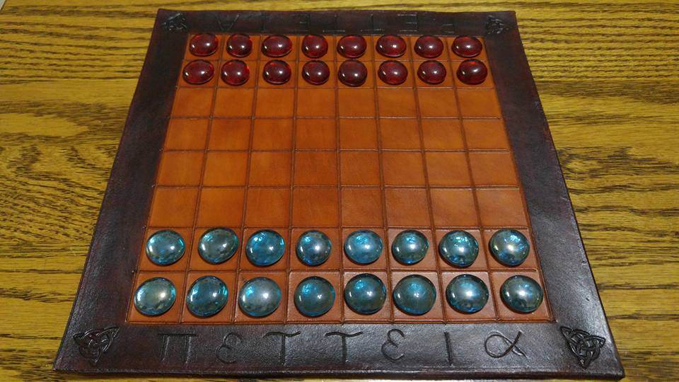 Petteia : an ancient Greek board game.