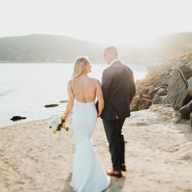 OATS bride @kstar_ernst glowing with that backless dress 😍 @sandcastlecelebrations @lori_boe_floral @jakeandnecia @trumpetvinecatering @avilabeachgolfresort @danielledentoniartistry @thehubsfilms
