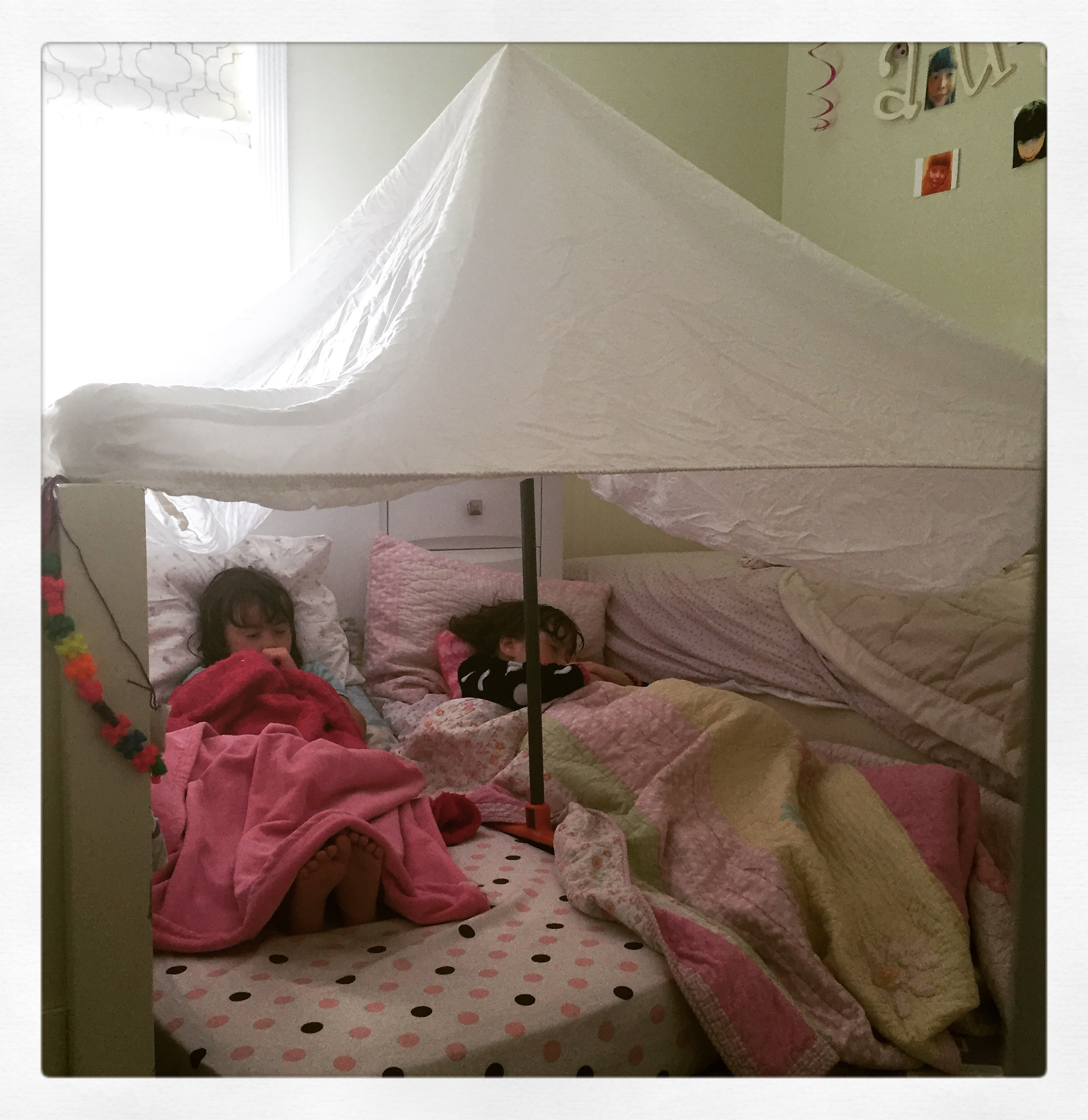 """I call this """"Fort Bed Knobs and Broomsticks"""". A cozy place for an afternoon nap or a great reading nook!"""