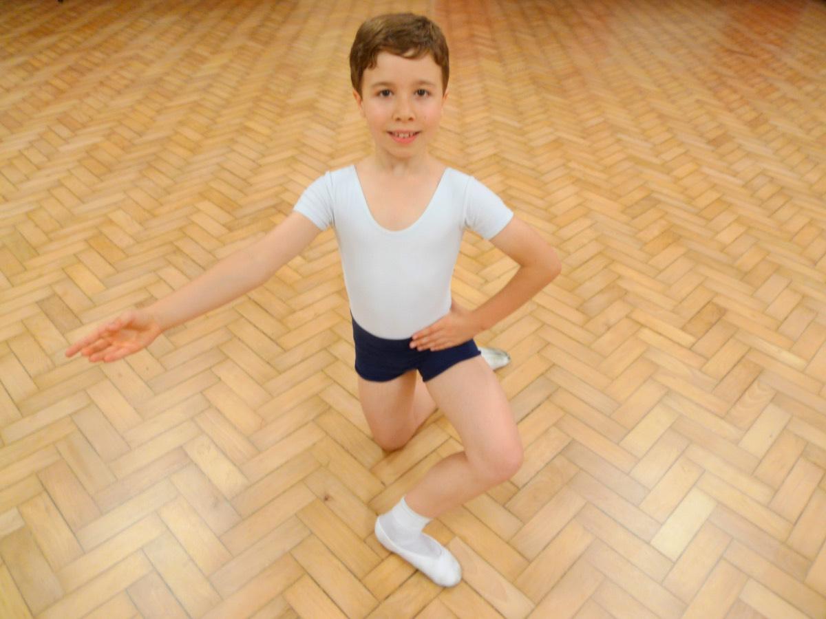 Boy, kneeling, smiling, ballet