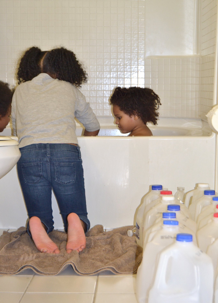 Mari Copeny - this is an image of Mari Copeny (Little Ms. Flint) at the age of 6,showing the world how herself and the people of Flint,MI bathe everyday due to the contaminated water.