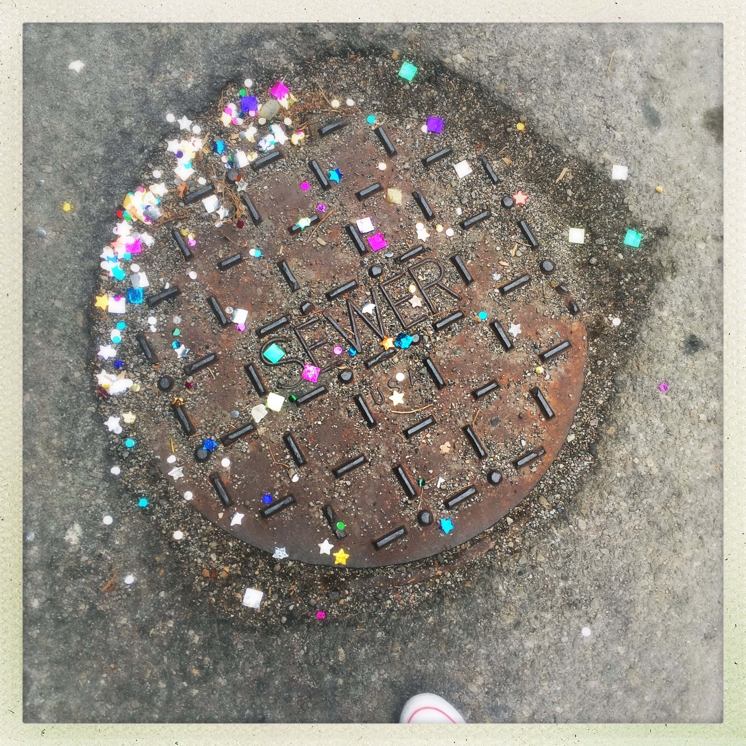 cast in a fit of festivity of some kind. and then very difficult to sweep up. now possibly causing digestive distress to the birds who forage by the dumpster nearby. but very sparkly.