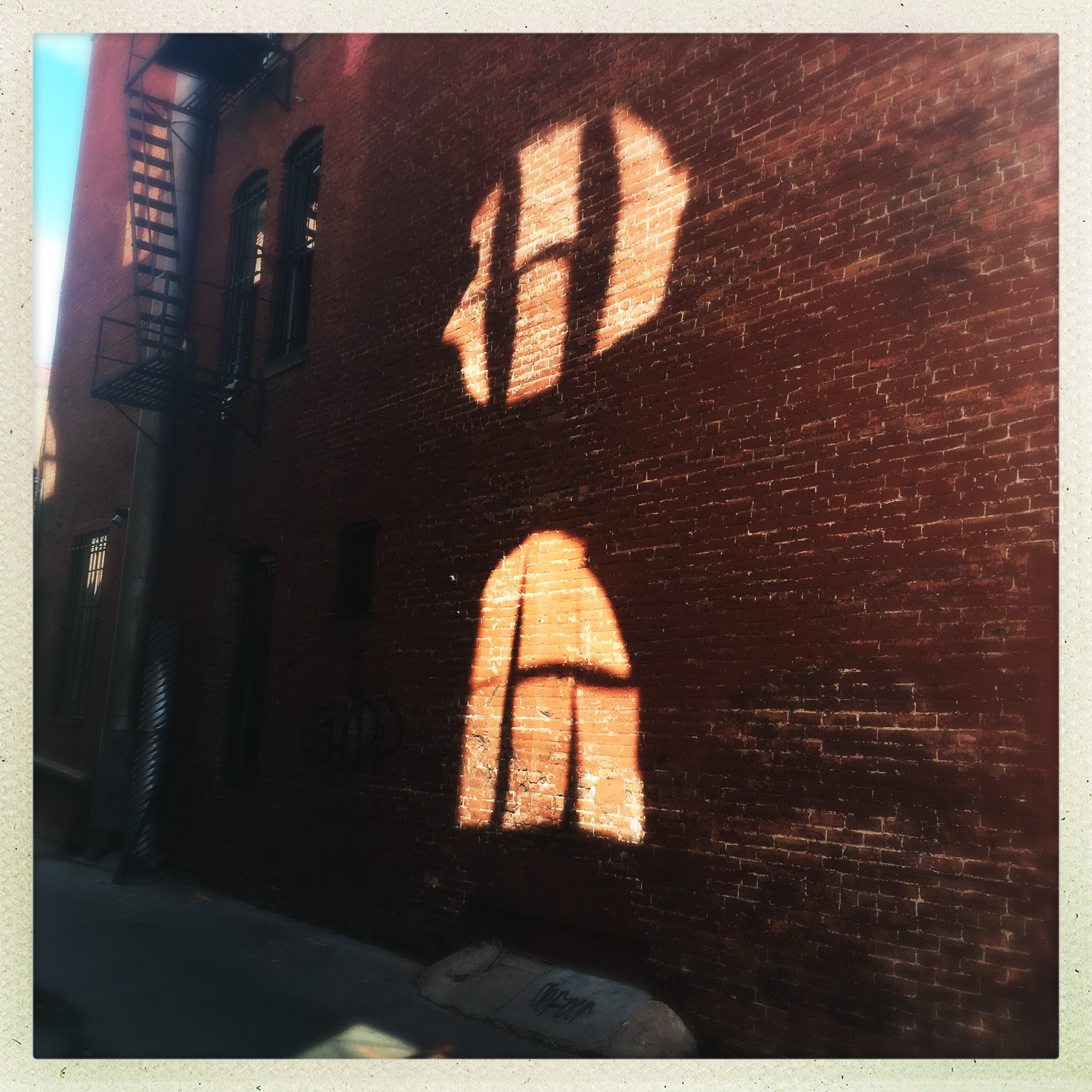 a strange figural configuration of reflections, near Union Station.