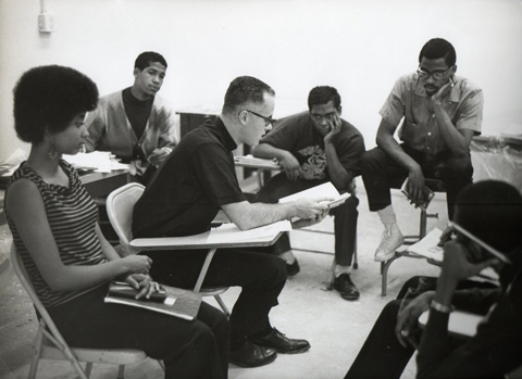 Father O'Brien teaching a course at HP
