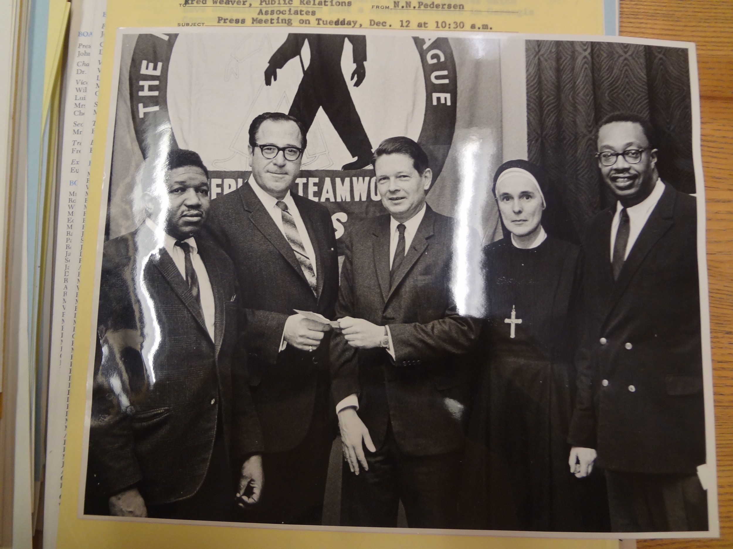 A photo from the December 1967 press conference with the Carnegie Corporation and the NYUL to acknowledge Carnegie's $300,00 grant. Left to right: Ed Carpenter, John Mosler, Alan Pifer, Mother Ruth Dowd, Eugene Callender