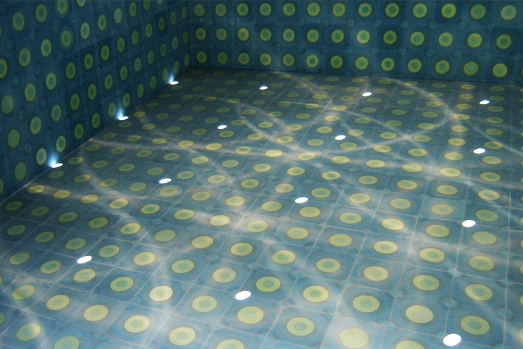 Blue Oasis, San Luis Potosi, Mexico, 2011. Permanent collection Sculpture Park San Luis Potosi.   Detail tiled floor with light reflections from wall and ceiling perforations.