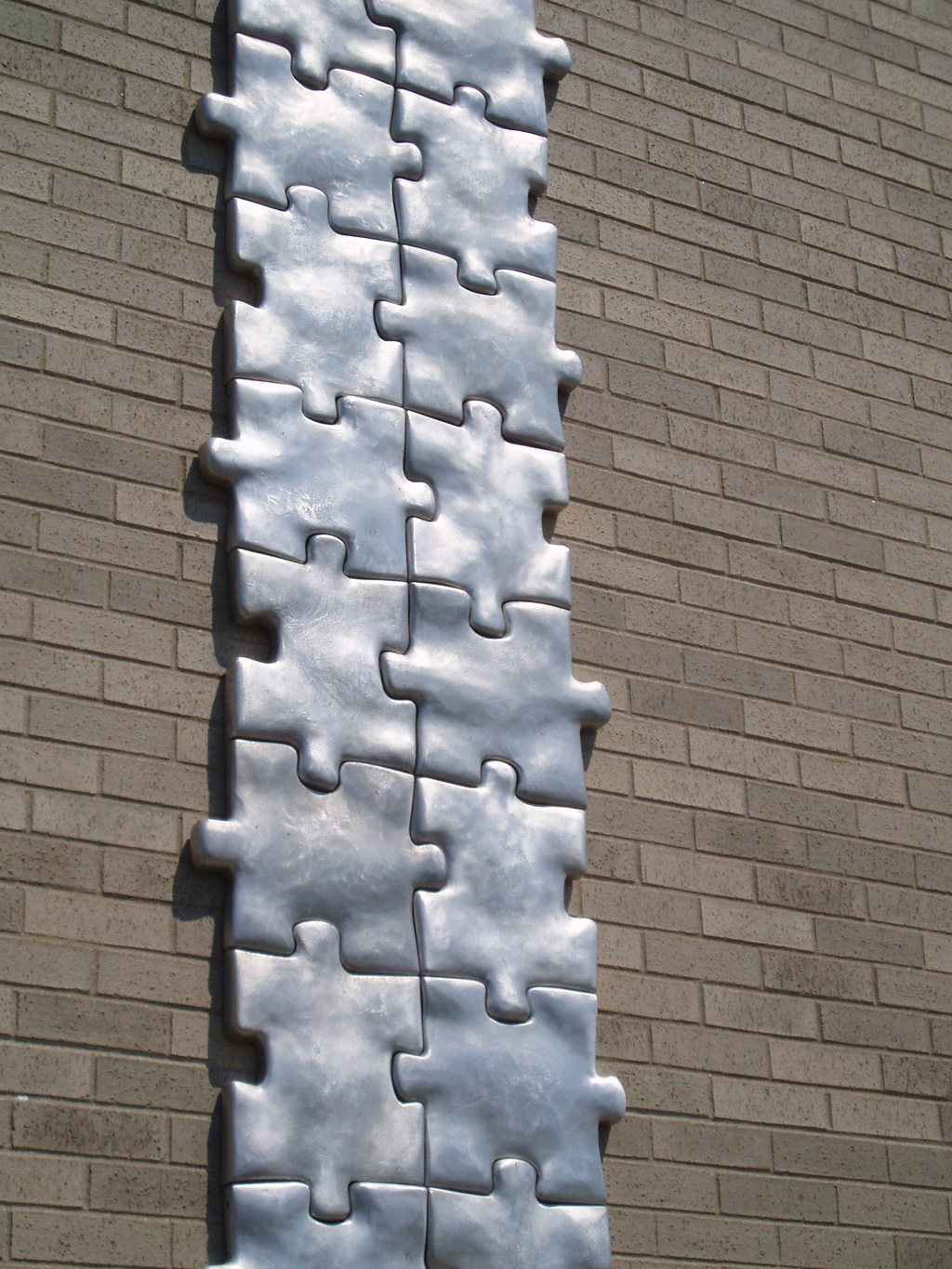 "Puzzled, 1998-1999. Cast Aluminum, 432""h X 24""w X 2""d, detail. Permanent Collection Plattsburgh Sculpture Park. Myers Fine Arts Building"