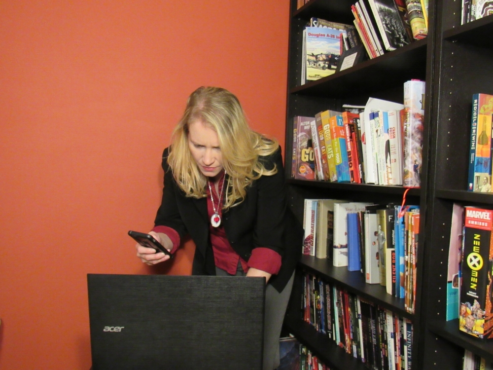 This is me, working intently as a social media manager, at home. My husband said I should blur the books, so as not to offend people (??), but this is me, being real. So, go ahead and be offended you weird world.